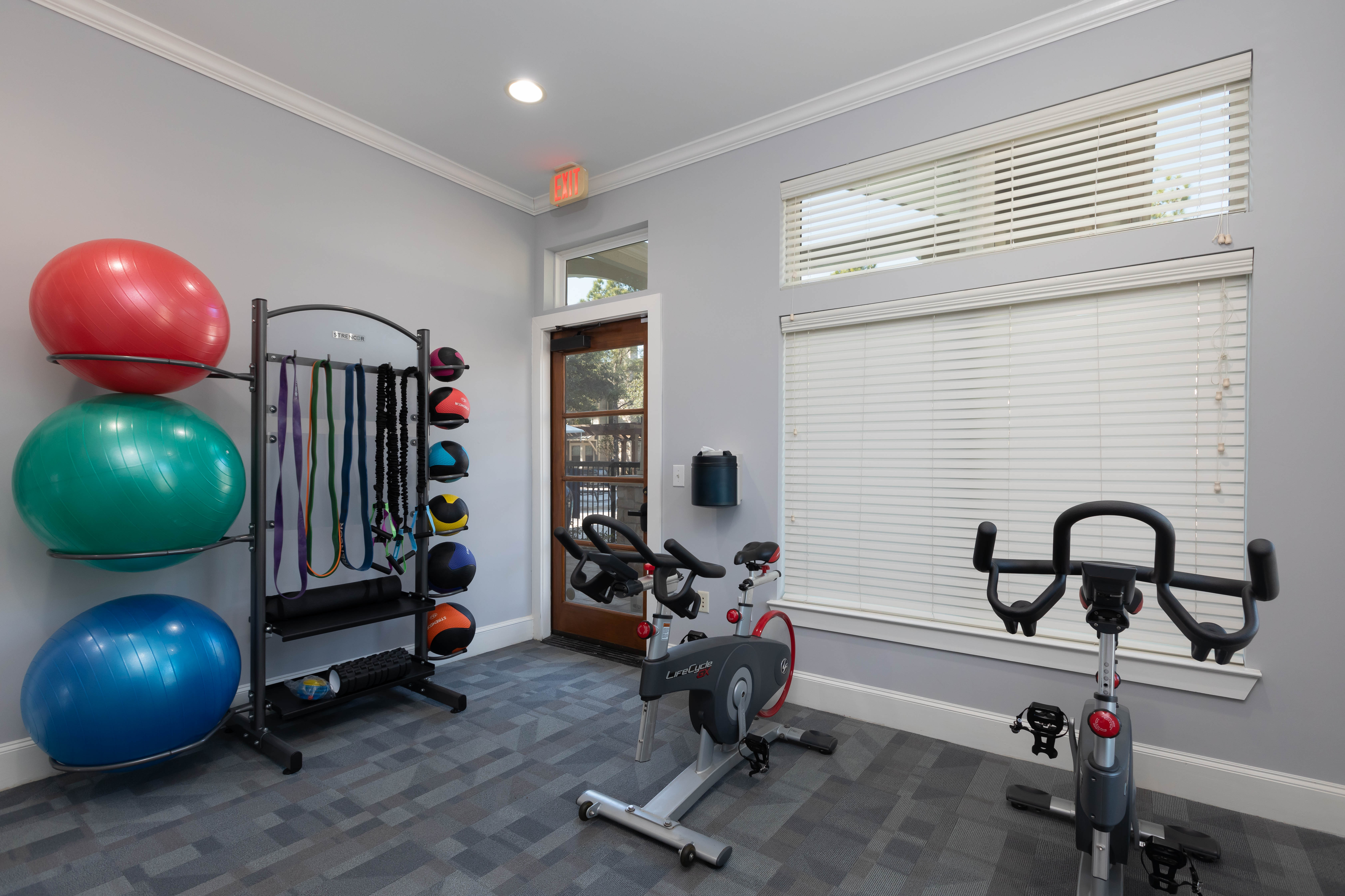 Modern spin room and fitness center at Lakefront Villas