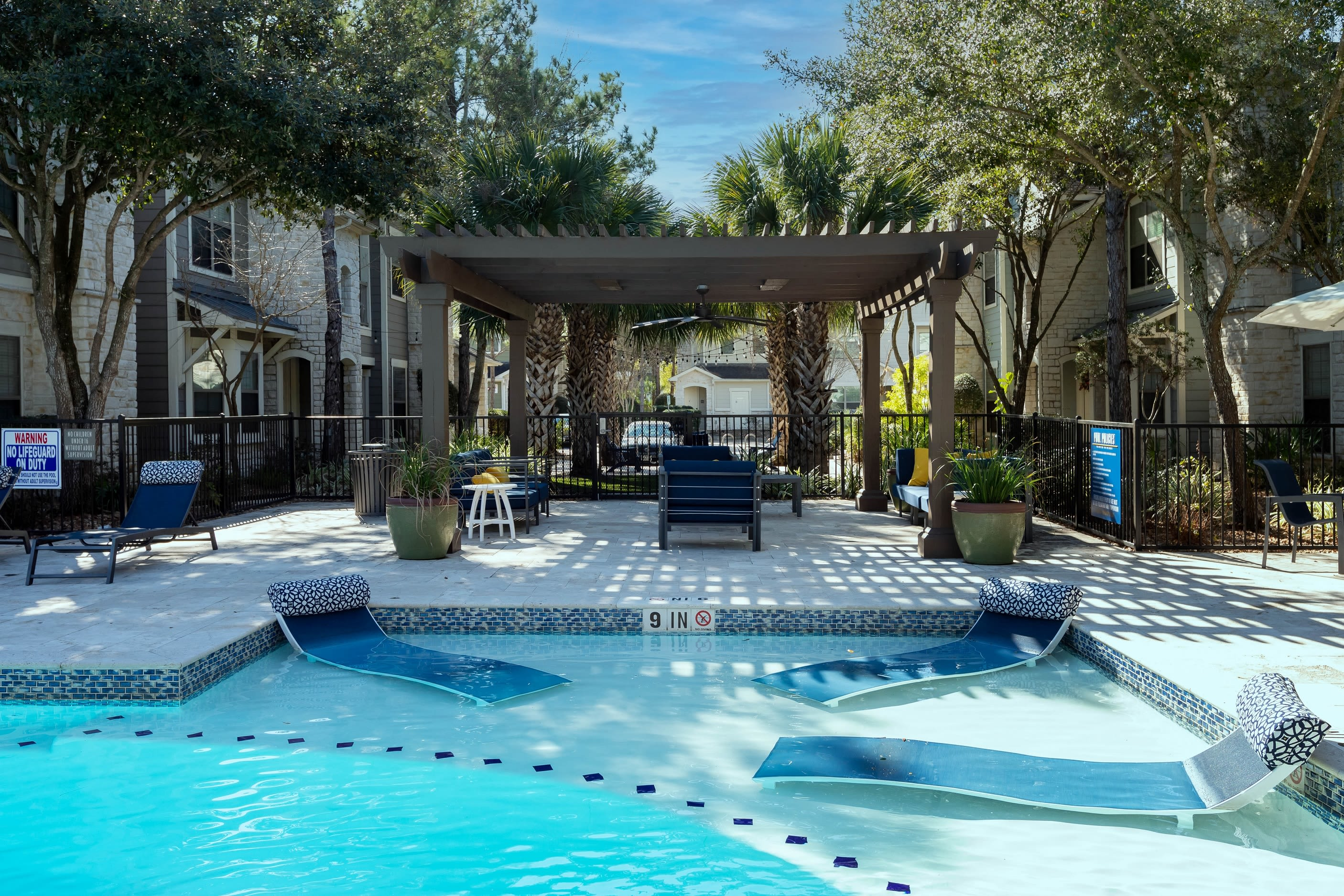 Resort style pool with sundeck at Lakefront Villas