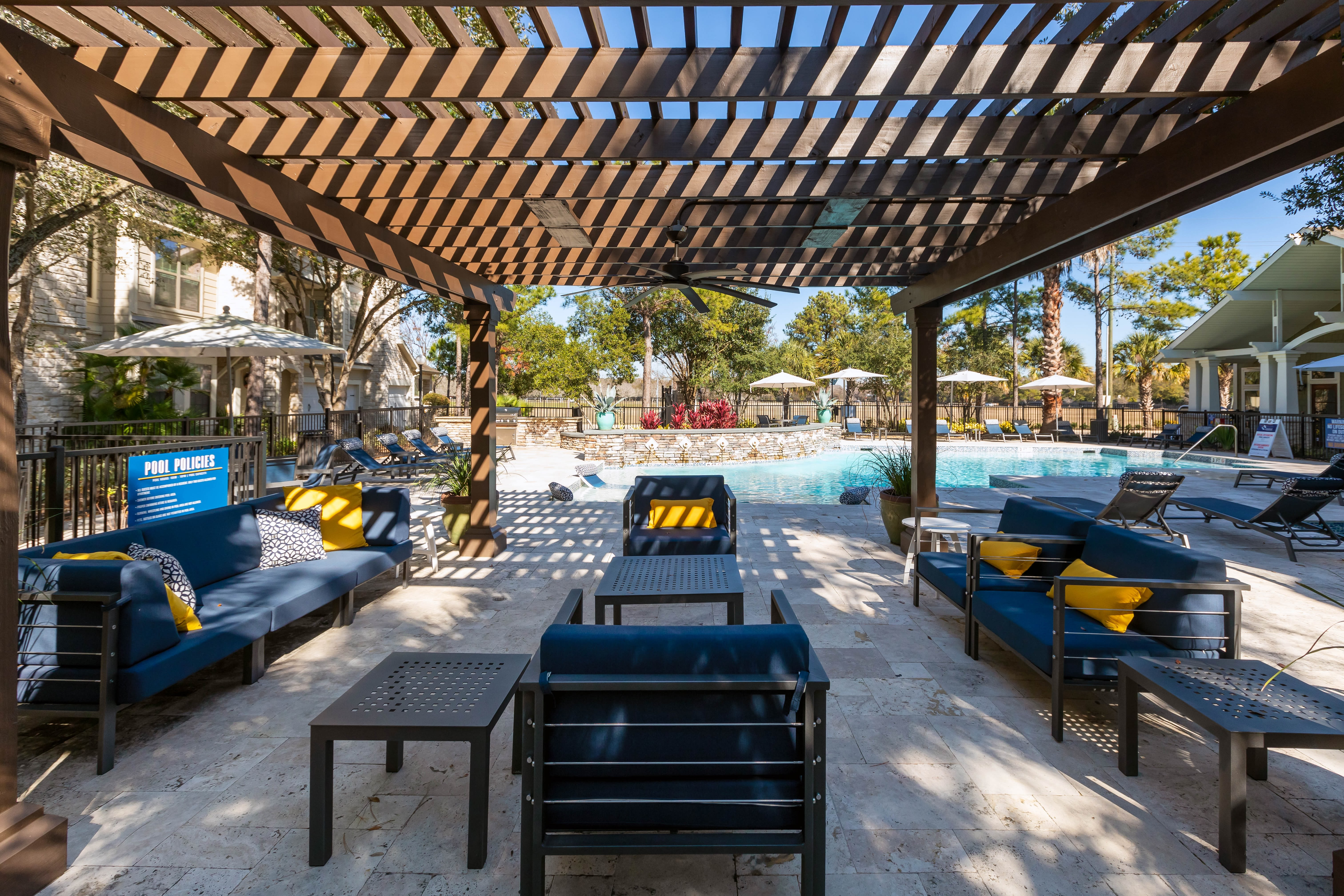 Lounge chairs poolside at Lakefront Villas in Houston, Texas