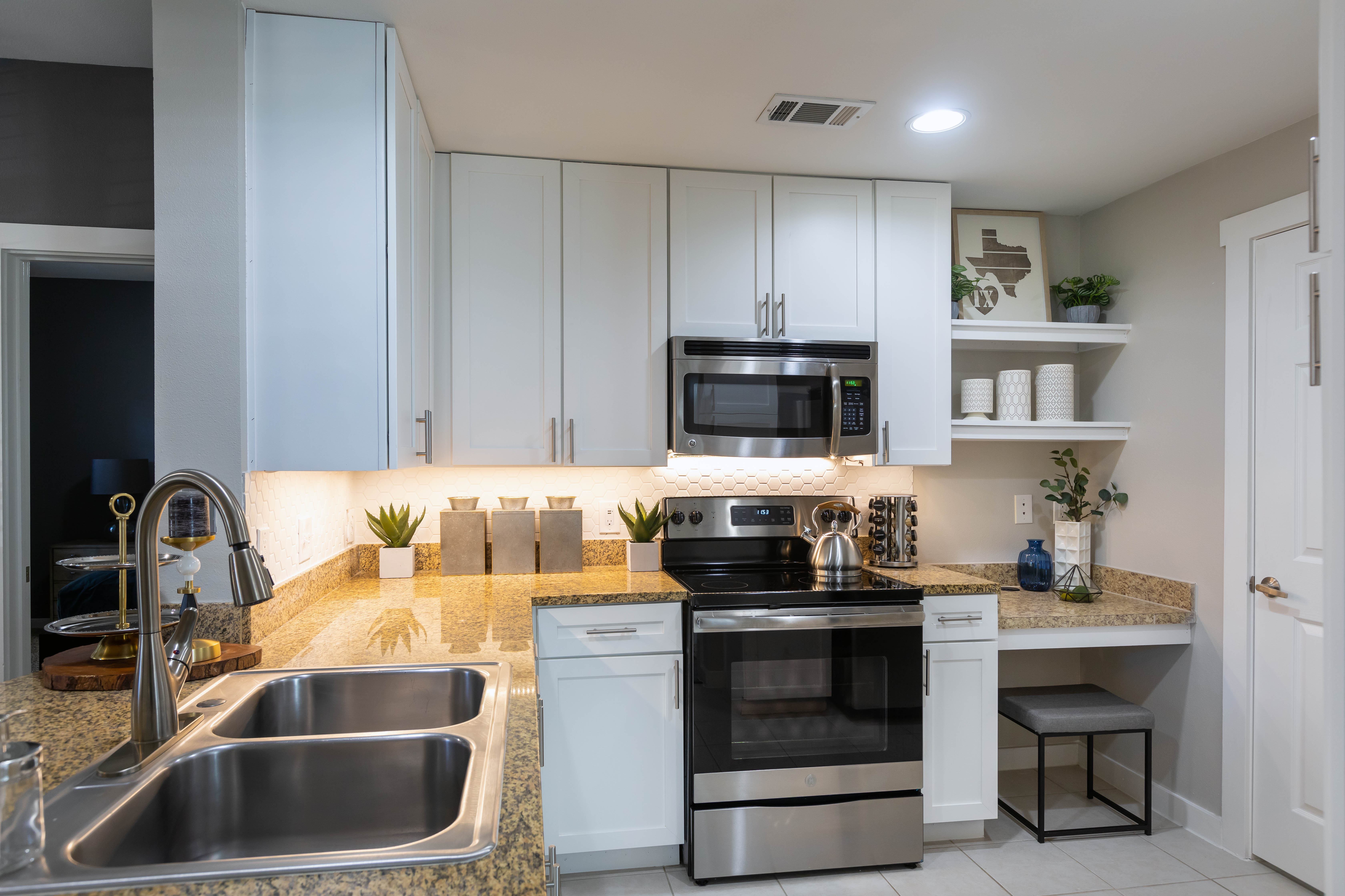 Kitchen with new interiors including Stainless steel appliances