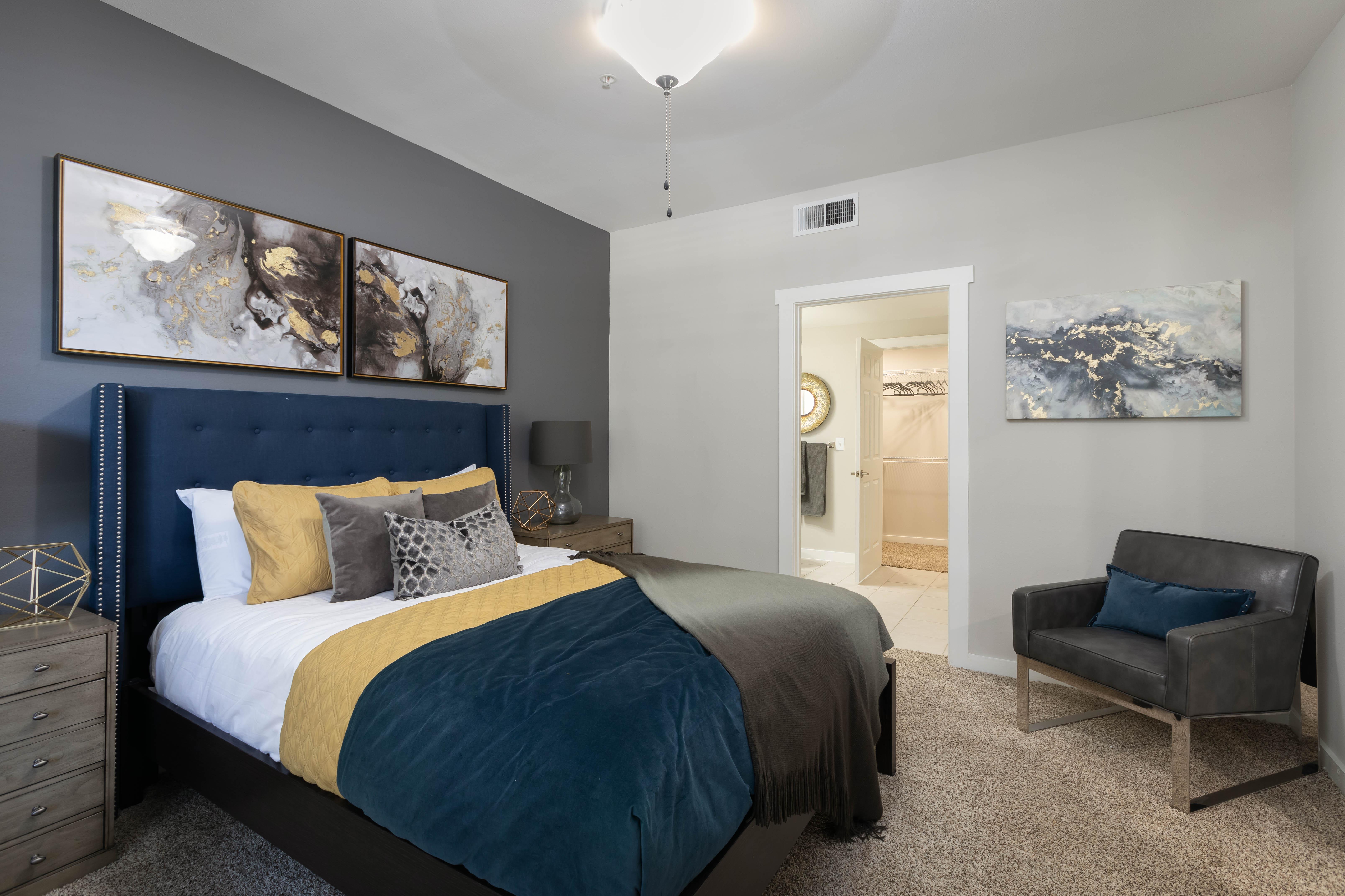 Well lit bedroom at Lakefront Villas in Houston, Texas