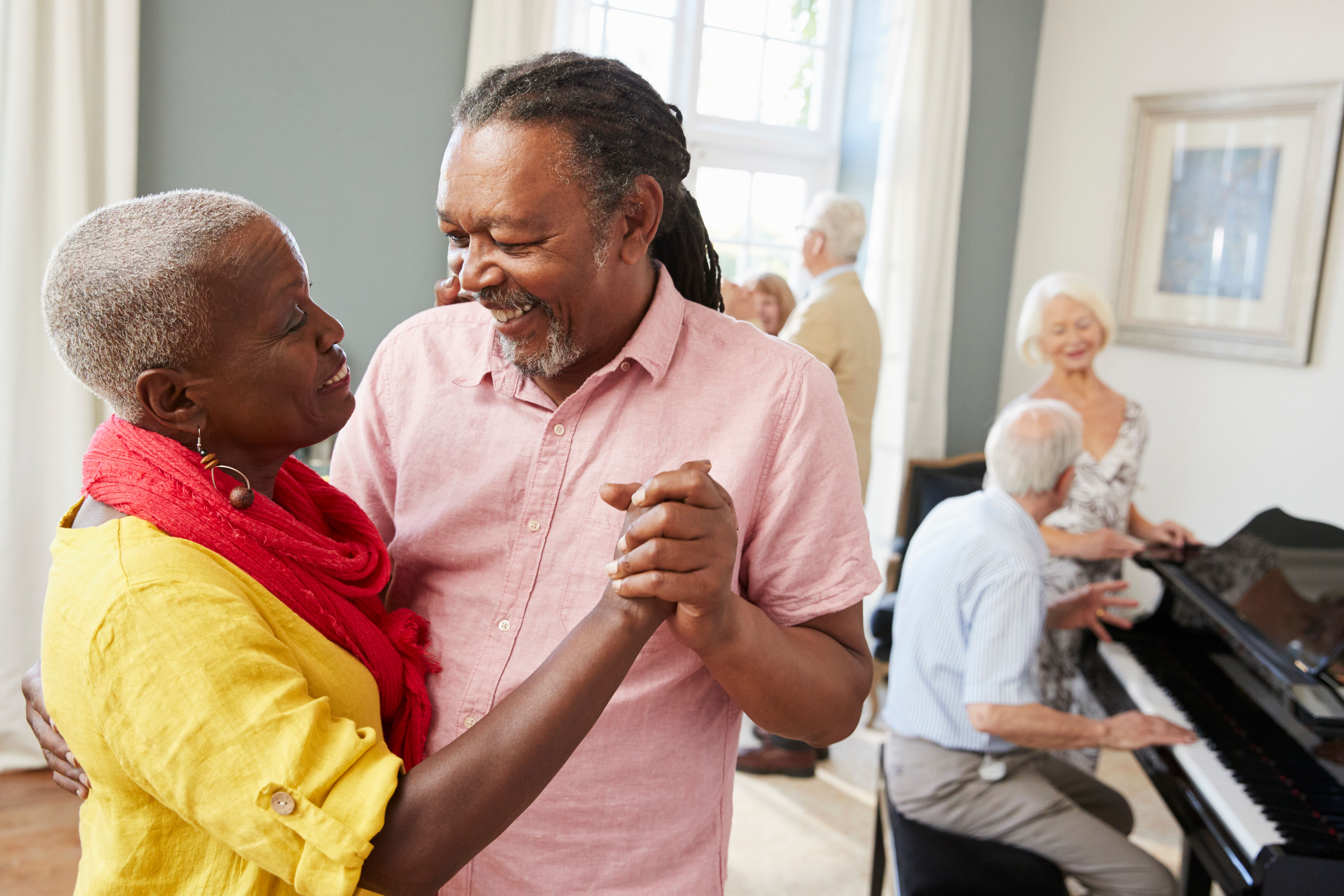 Residents dancing in a lounge at York Gardens in Edina, Minnesota