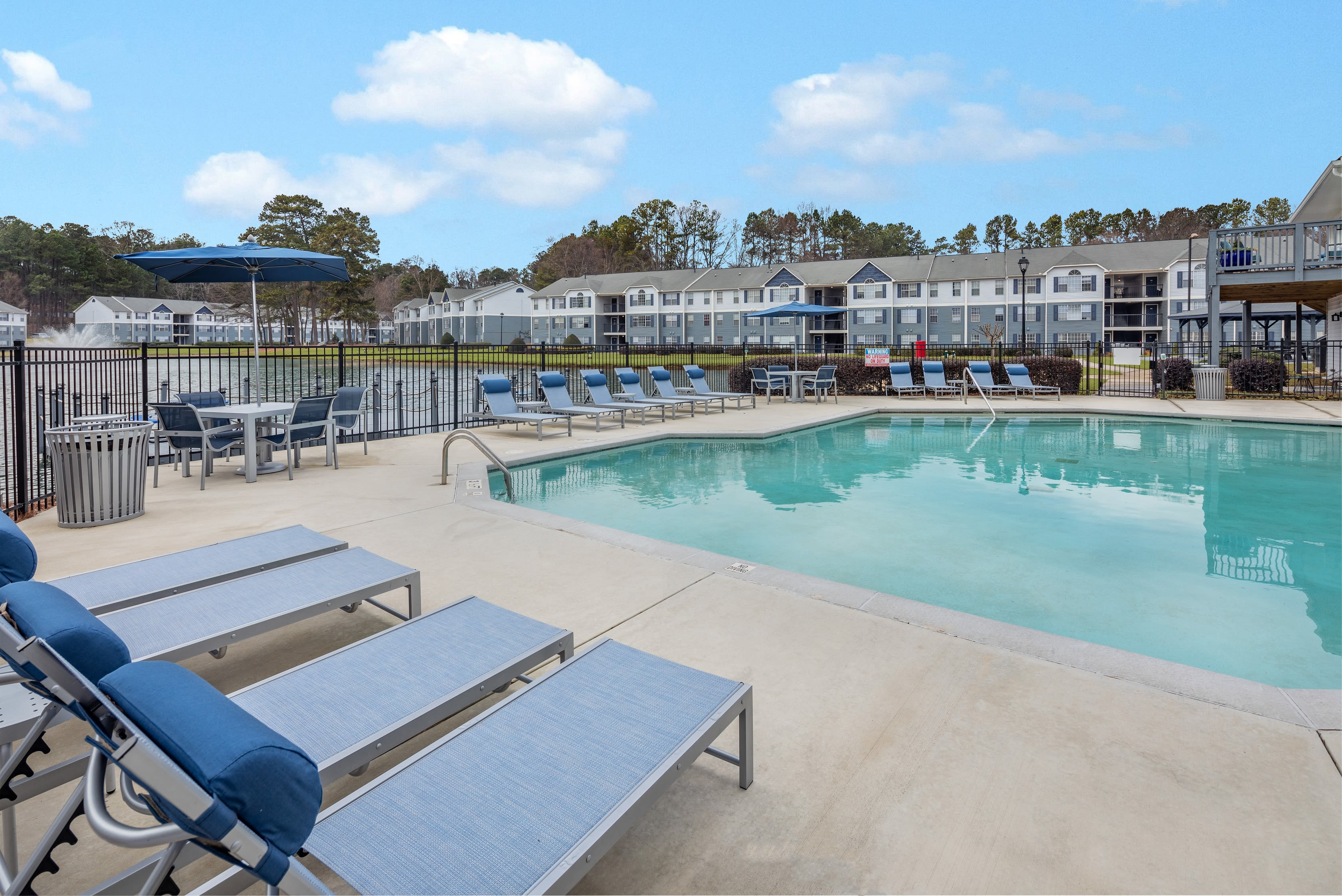 Resort inspired pool and sunning deck at The Bentley at Marietta in Marietta, GA