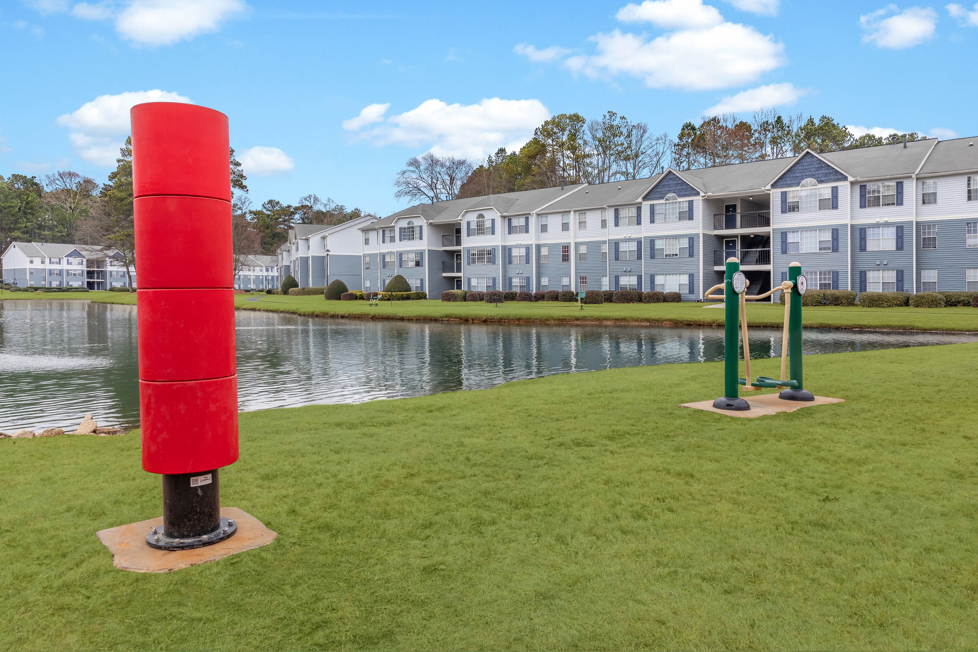 Outdoor, lakeside workout stations at The Bentley at Marietta in Marietta, GA