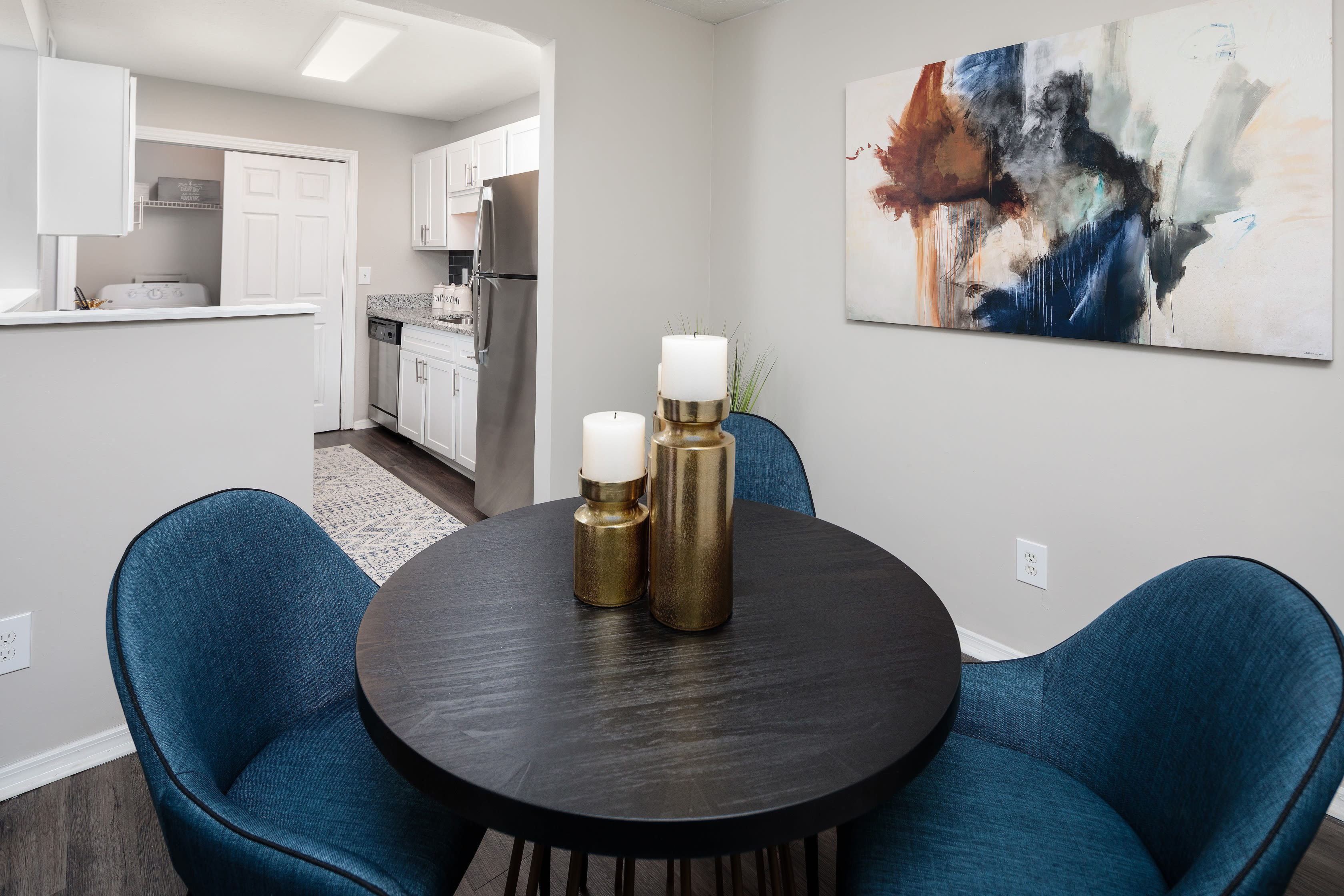 Stainless steel appliances and separate dining rooms at The Bentley at Marietta in Marietta, GA