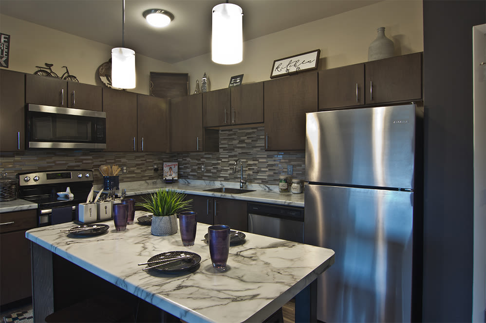 Modern kitchen with granite countertops at Park West 205 Apartment Homes in Pittsburgh, Pennsylvania