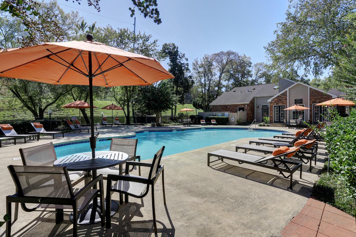 Shaded seating near the pool at Allegro on Bell in Antioch, Tennessee