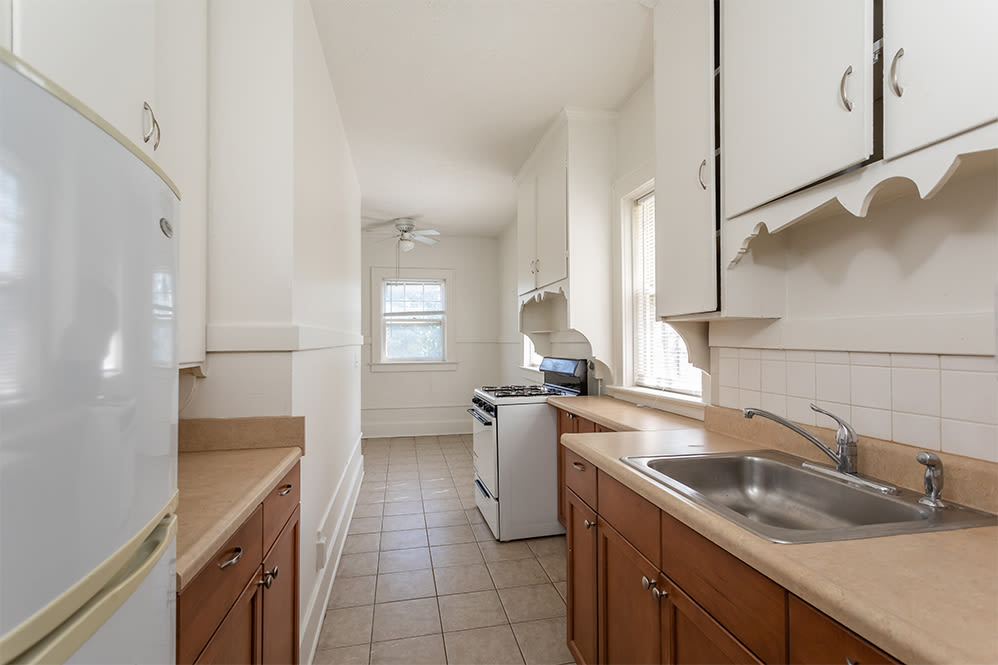 Galley kitchen at Colby, Carlton, and Colby Park Apartments in Rochester New York