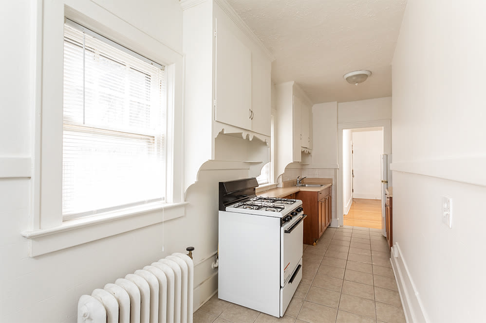 Naturally well-lit kitchen at Colby, Carlton, and Colby Park Apartments in Rochester New York