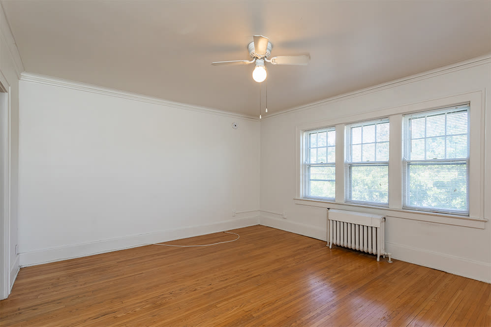 Spacious living room at Colby, Carlton, and Colby Park Apartments in Rochester, New York