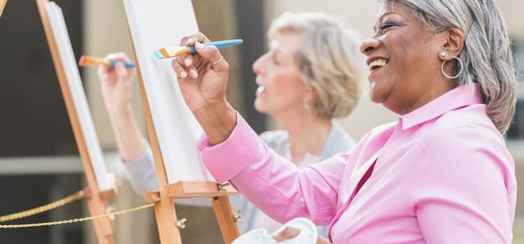 Two women painting at The Pointe at Summit Hills in Bakersfield, California