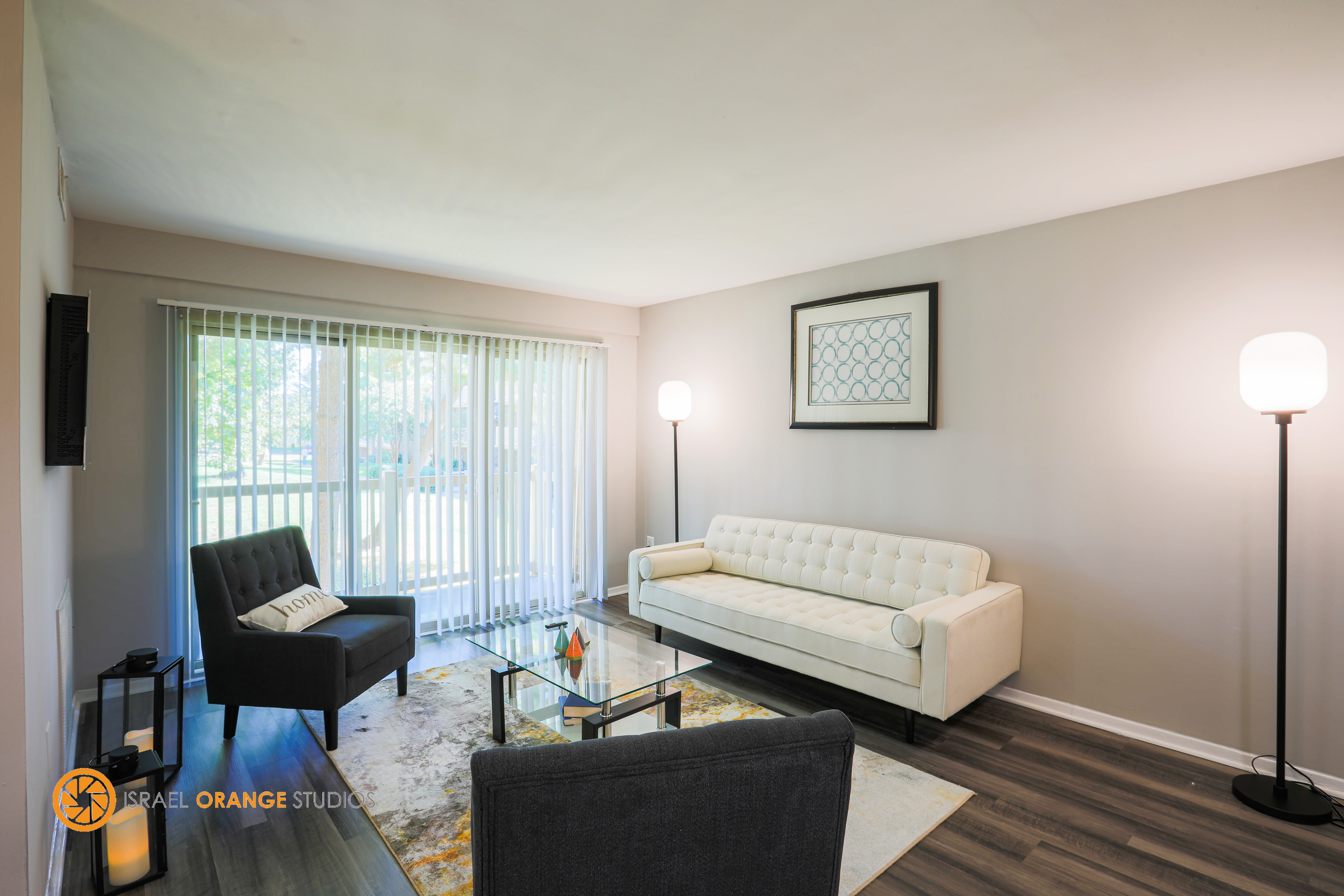 Cozy living room with couches next to window at The Glendale Residence in Lanham, Maryland