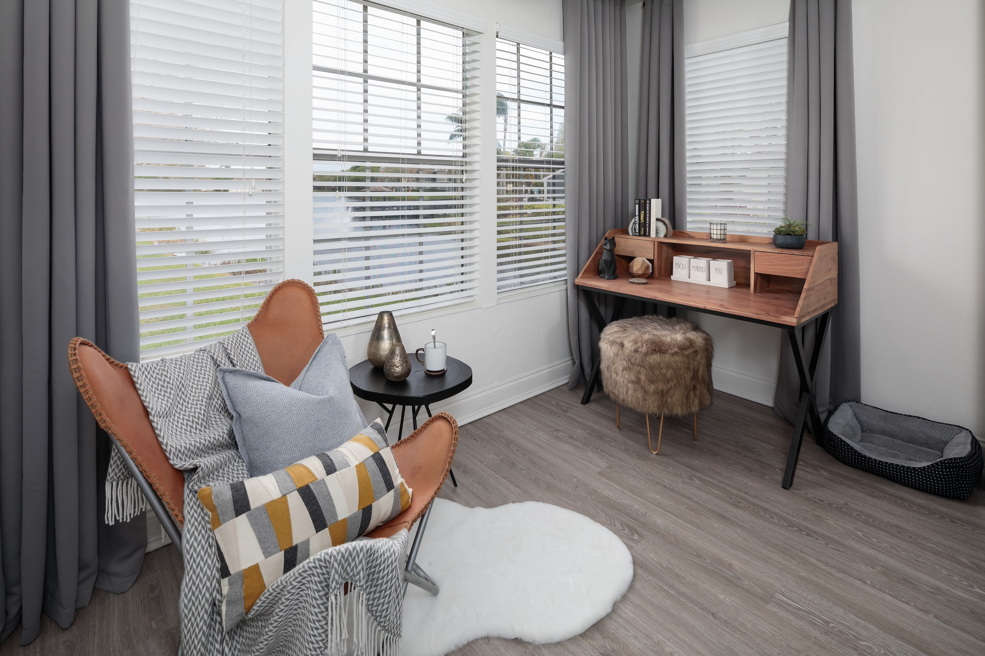 A desk and seating area in an apartment at Fairways at Feather Sound in Clearwater, FL