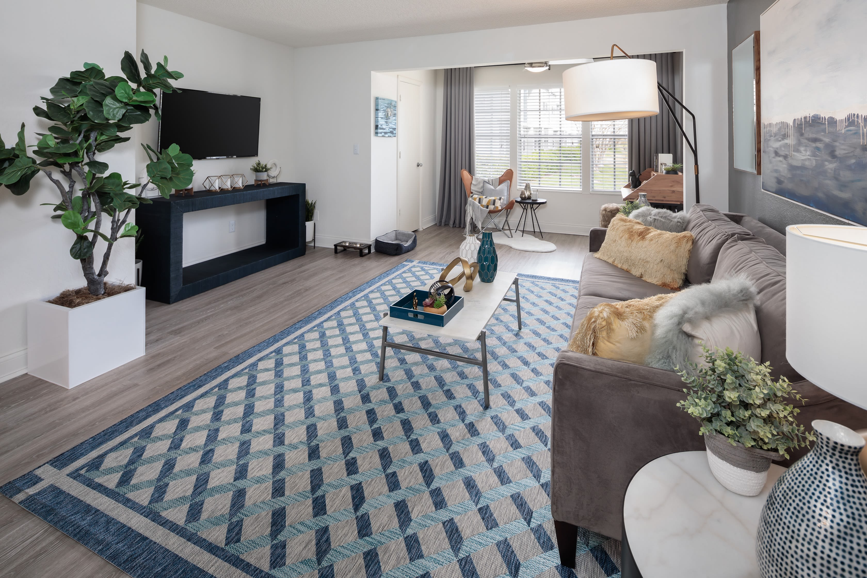 A furnished apartment living room at Fairways at Feather Sound in Clearwater, FL