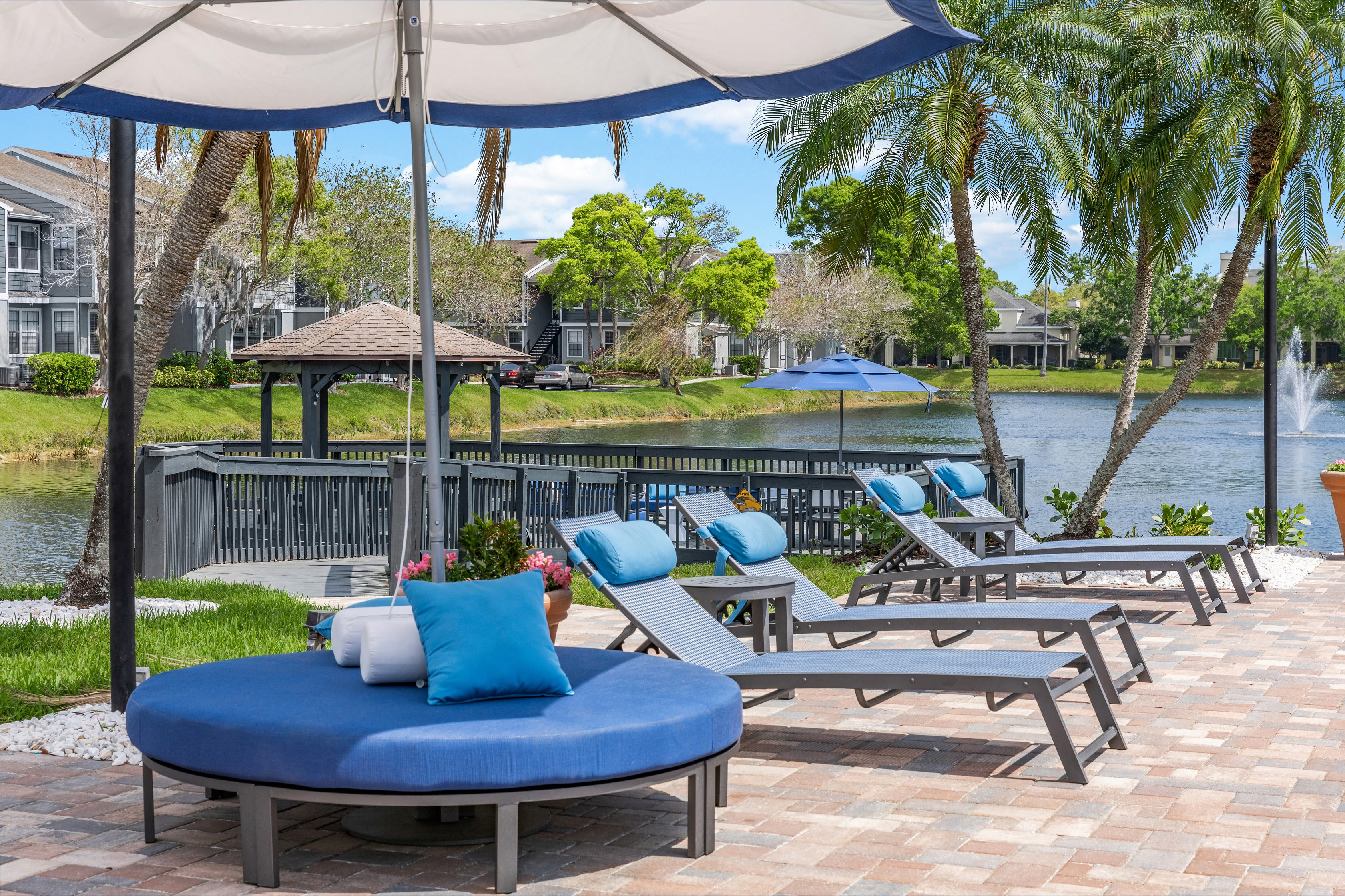 A lake in front of an apartment at Fairways at Feather Sound in Clearwater, FL
