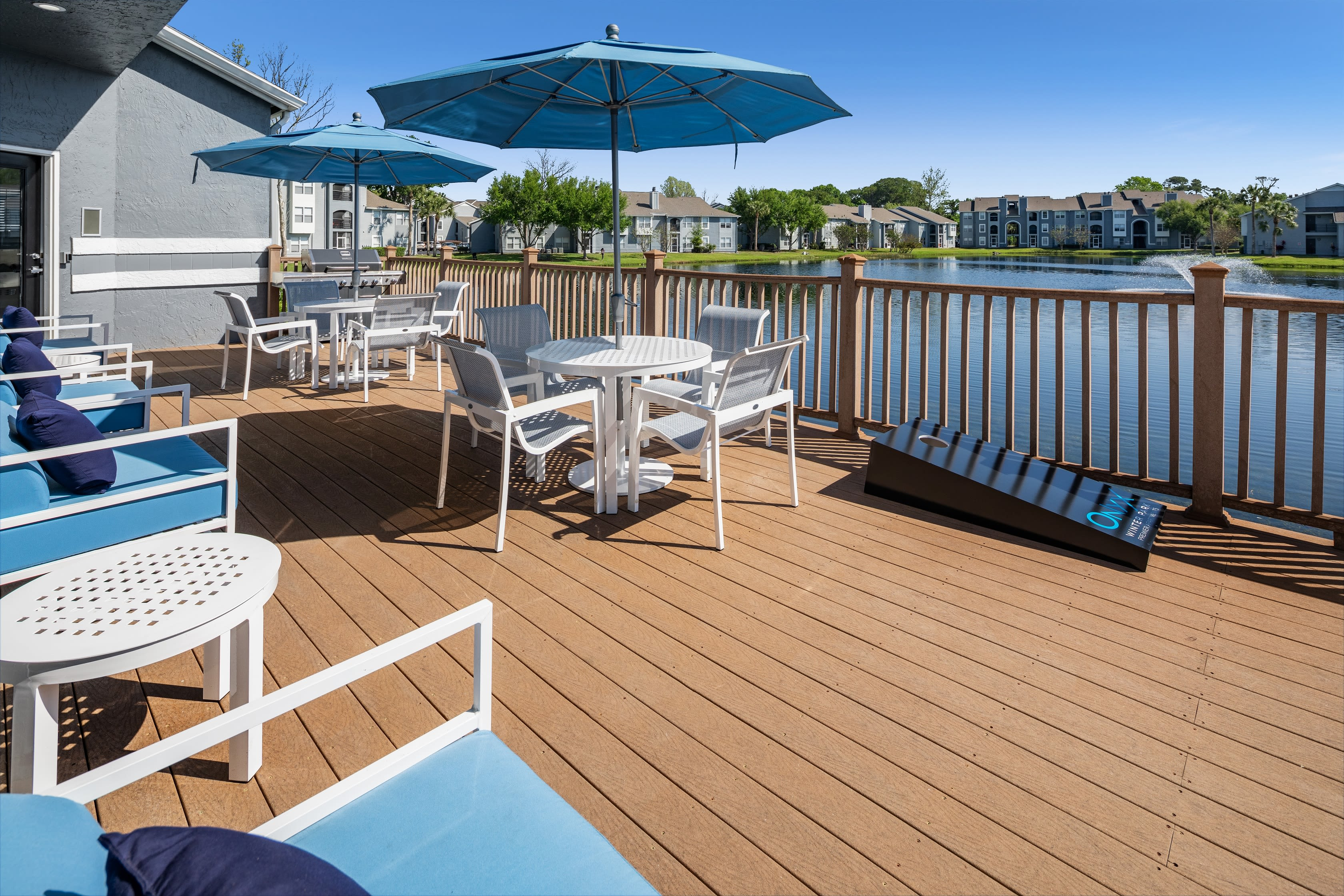 The dock with patio furniture at Onyx Winter Park in Casselberry, FL