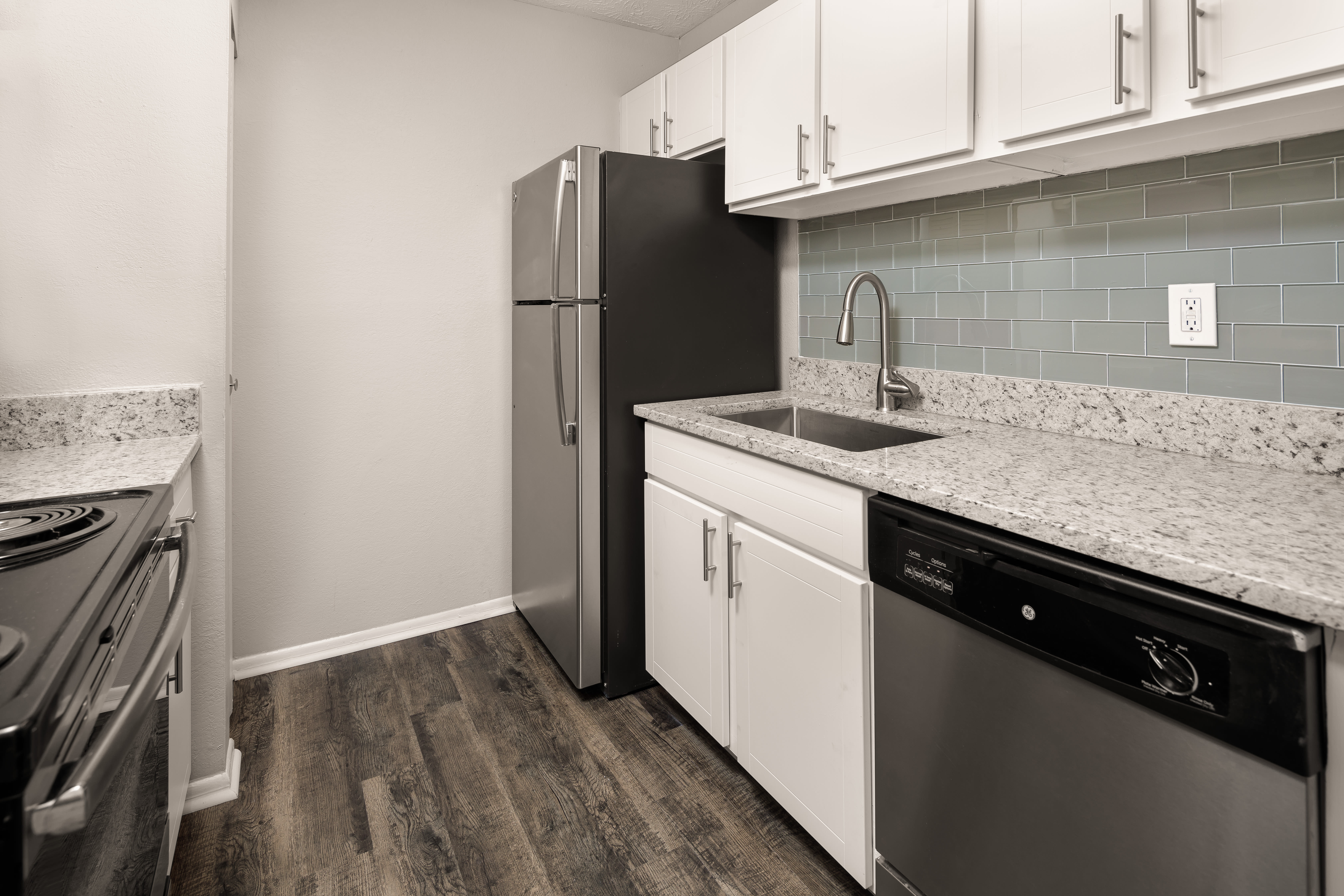 An apartment kitchen with new appliances at The Franklin in Marietta, GA