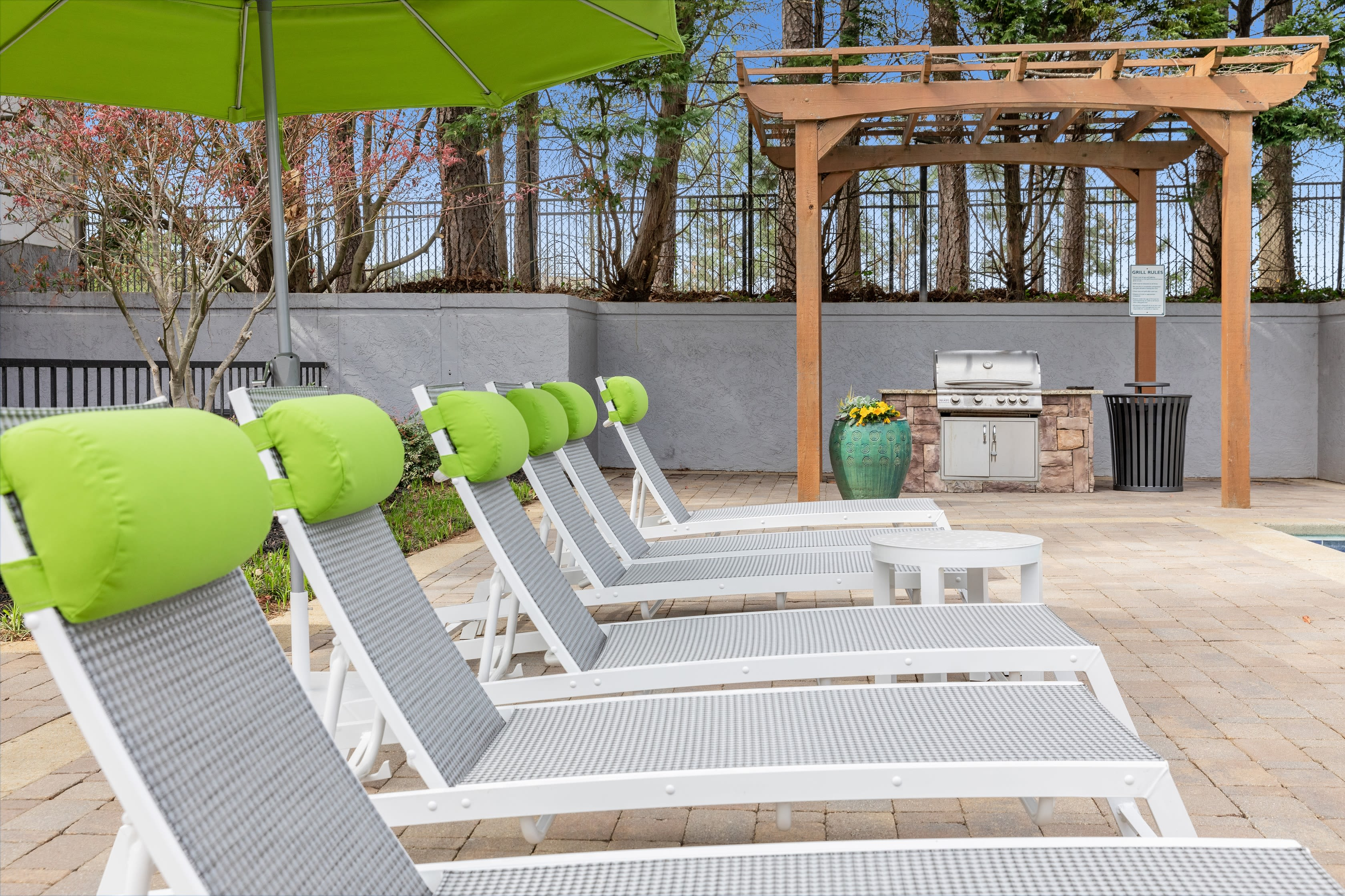 Lounging chairs poolside at The Franklin in Marietta, GA