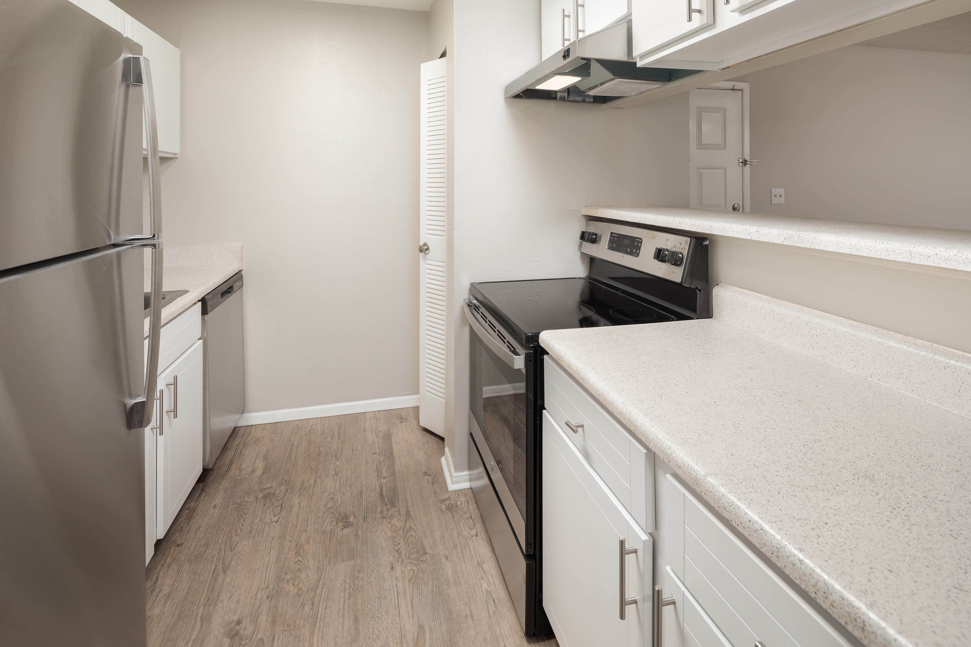 Updated appliances and countertops in a model home's kitchen at The Everette at East Cobb in Marietta, Georgia