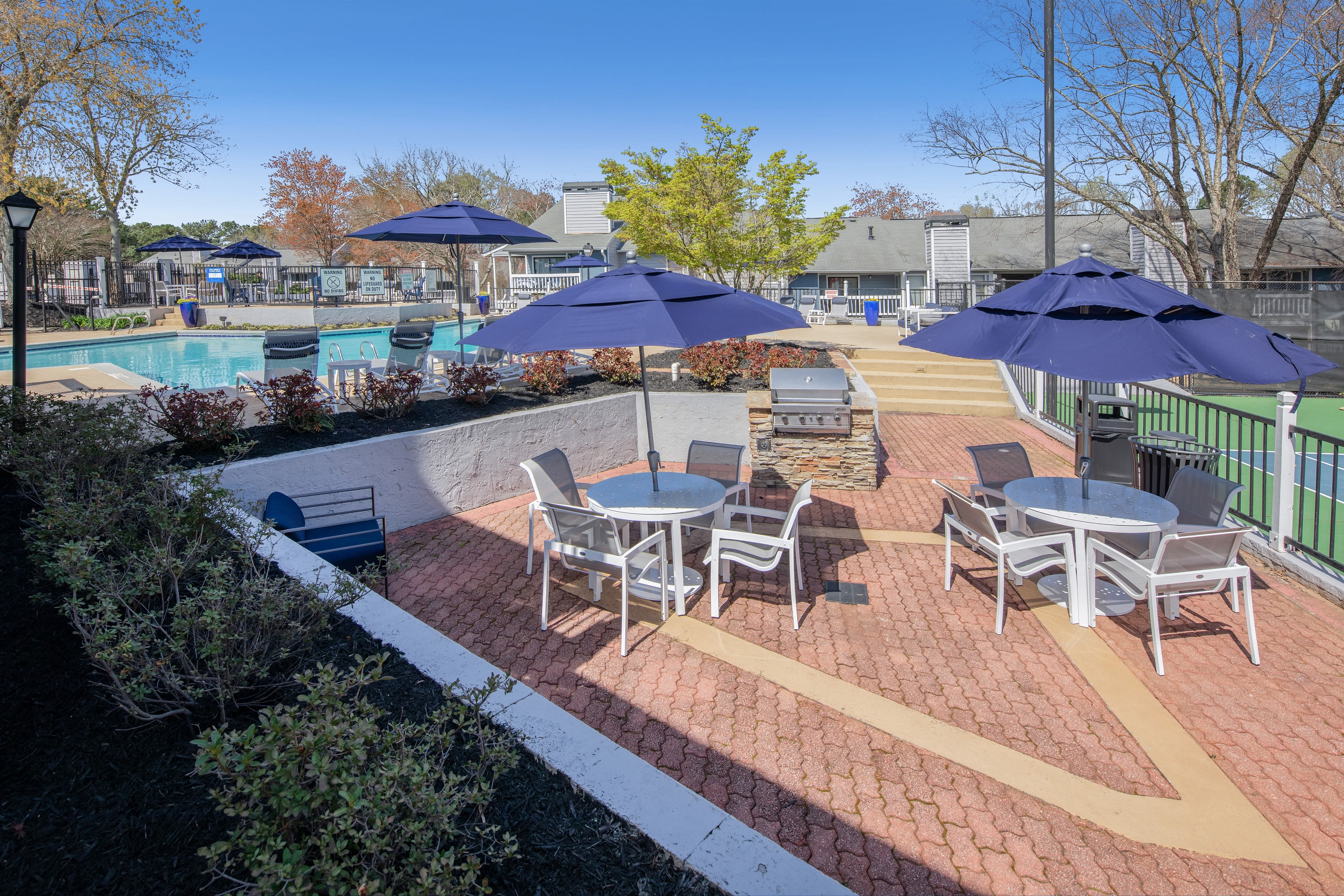 An outdoor seating area with tables and umbrellas at The Everette at East Cobb in Marietta, Georgia