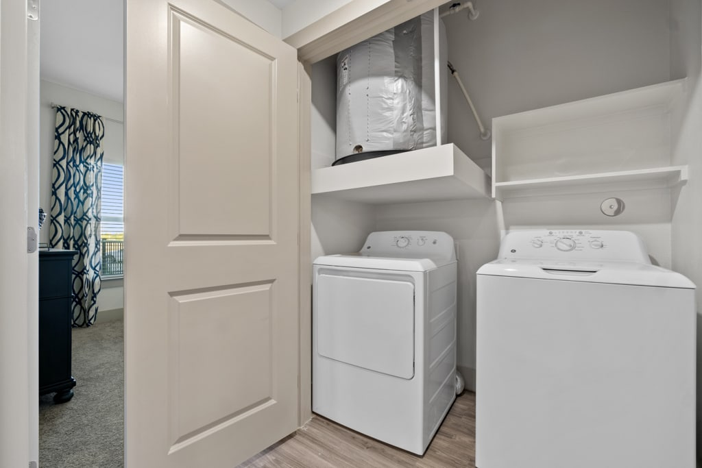 Laundry room with a washer and dryer at McCarty Commons in San Marcos, Texas