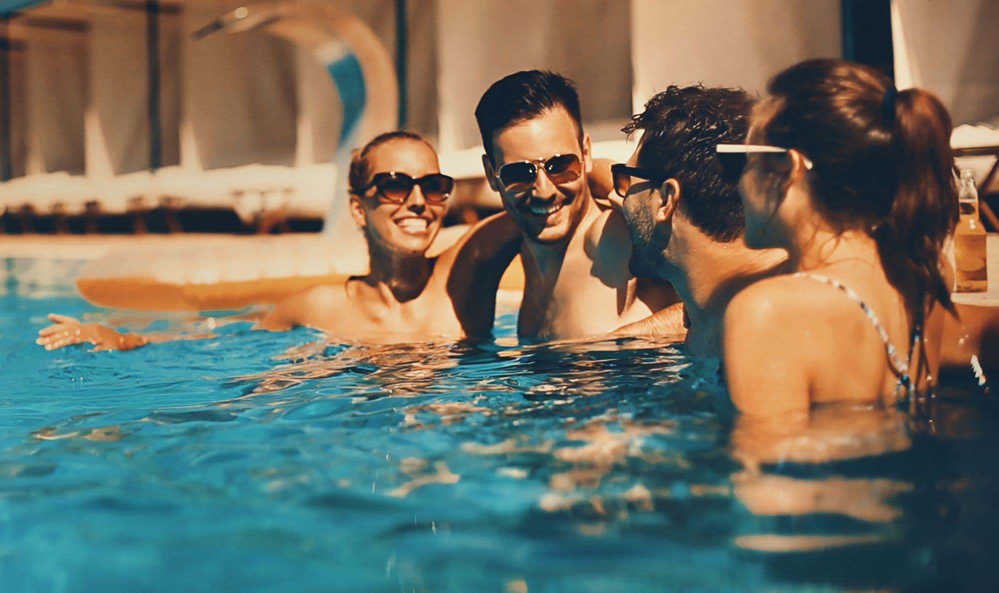 Friends hanging at the pool at Liberty SKY in Salt Lake City, Utah