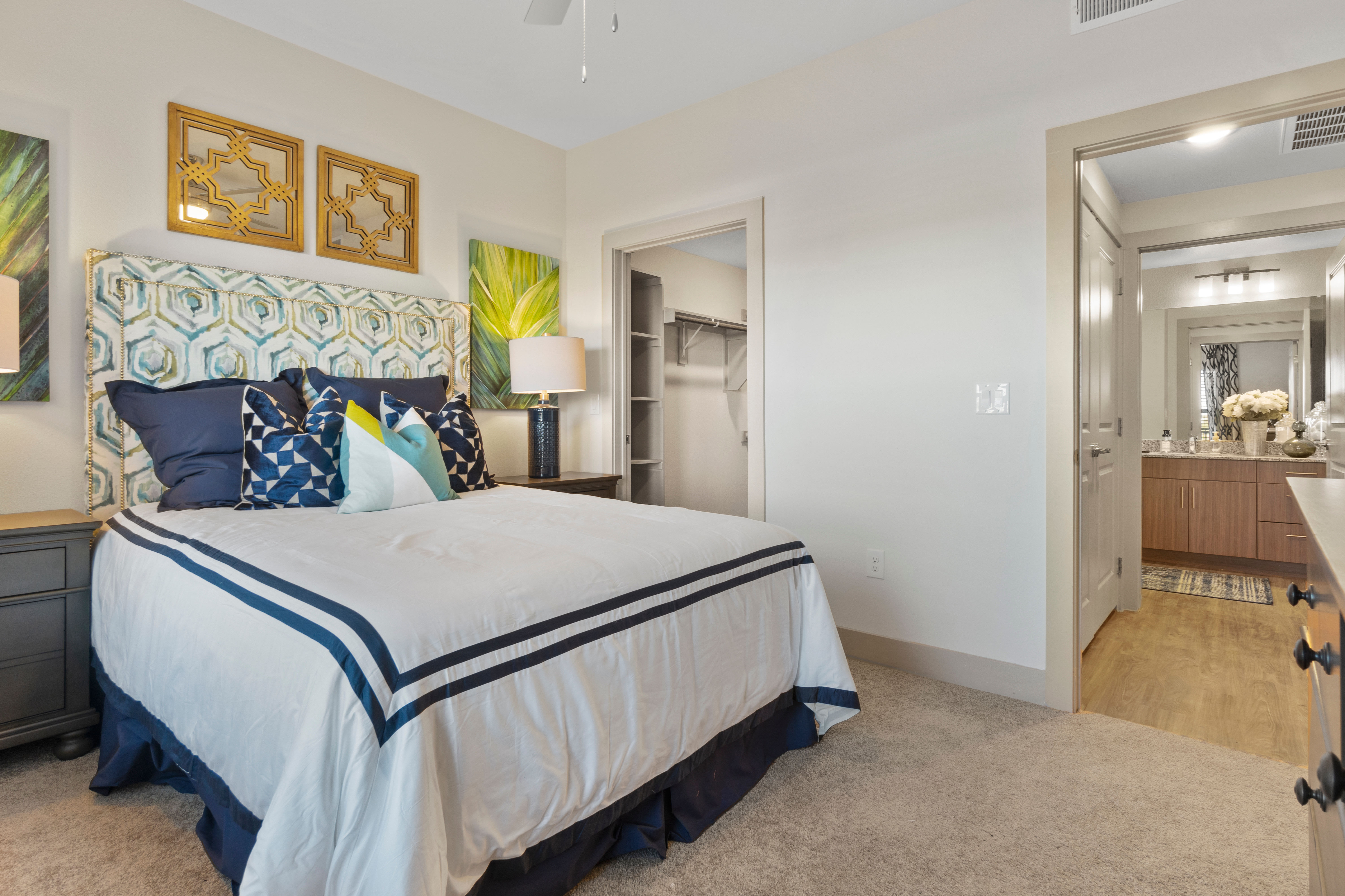 Bedroomwith plush carpeting at McCarty Commons in San Marcos, Texas