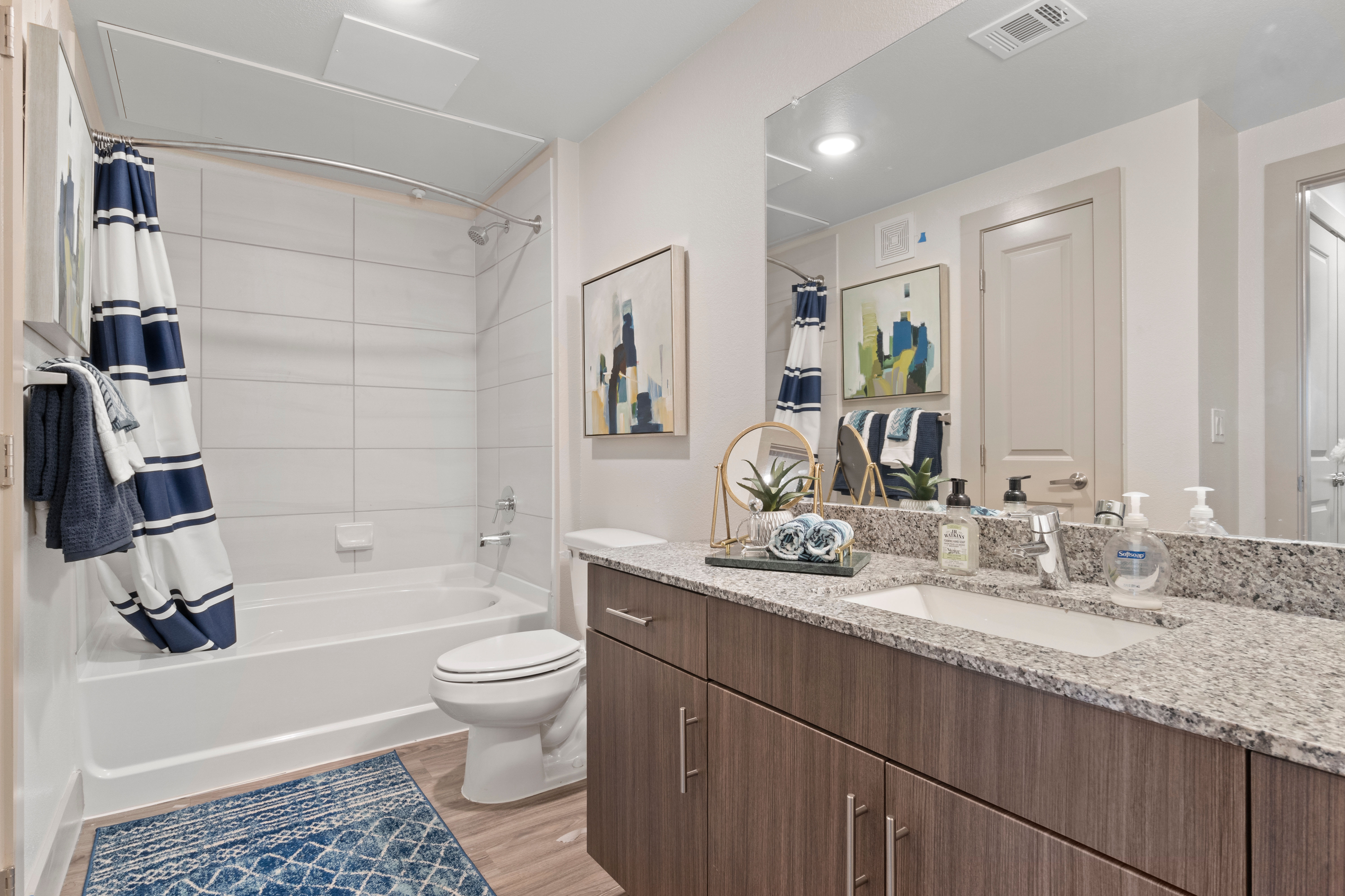 Bathroom with a large vanity at McCarty Commons in San Marcos, Texas
