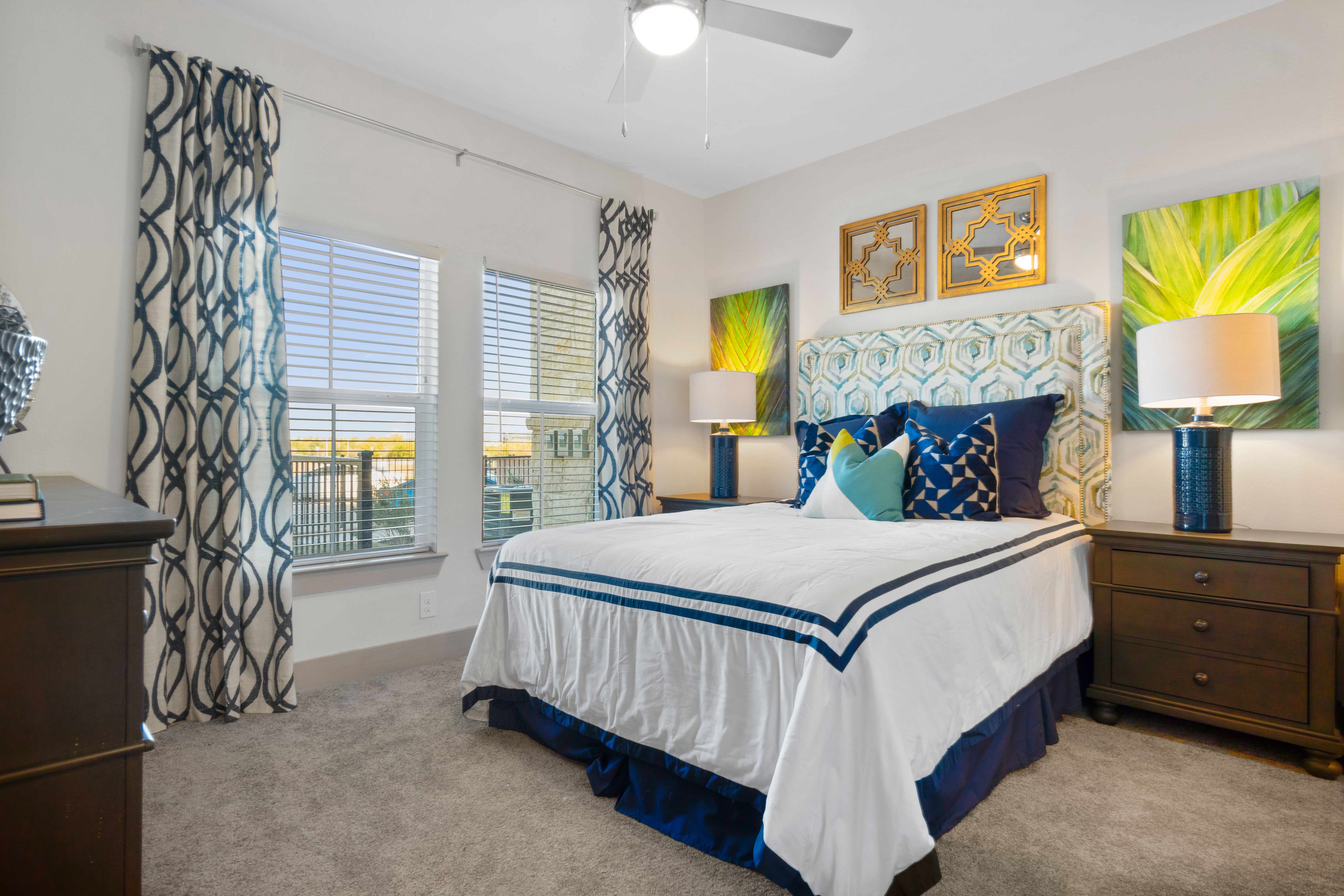 Bedroom with a large window at McCarty Commons in San Marcos, Texas