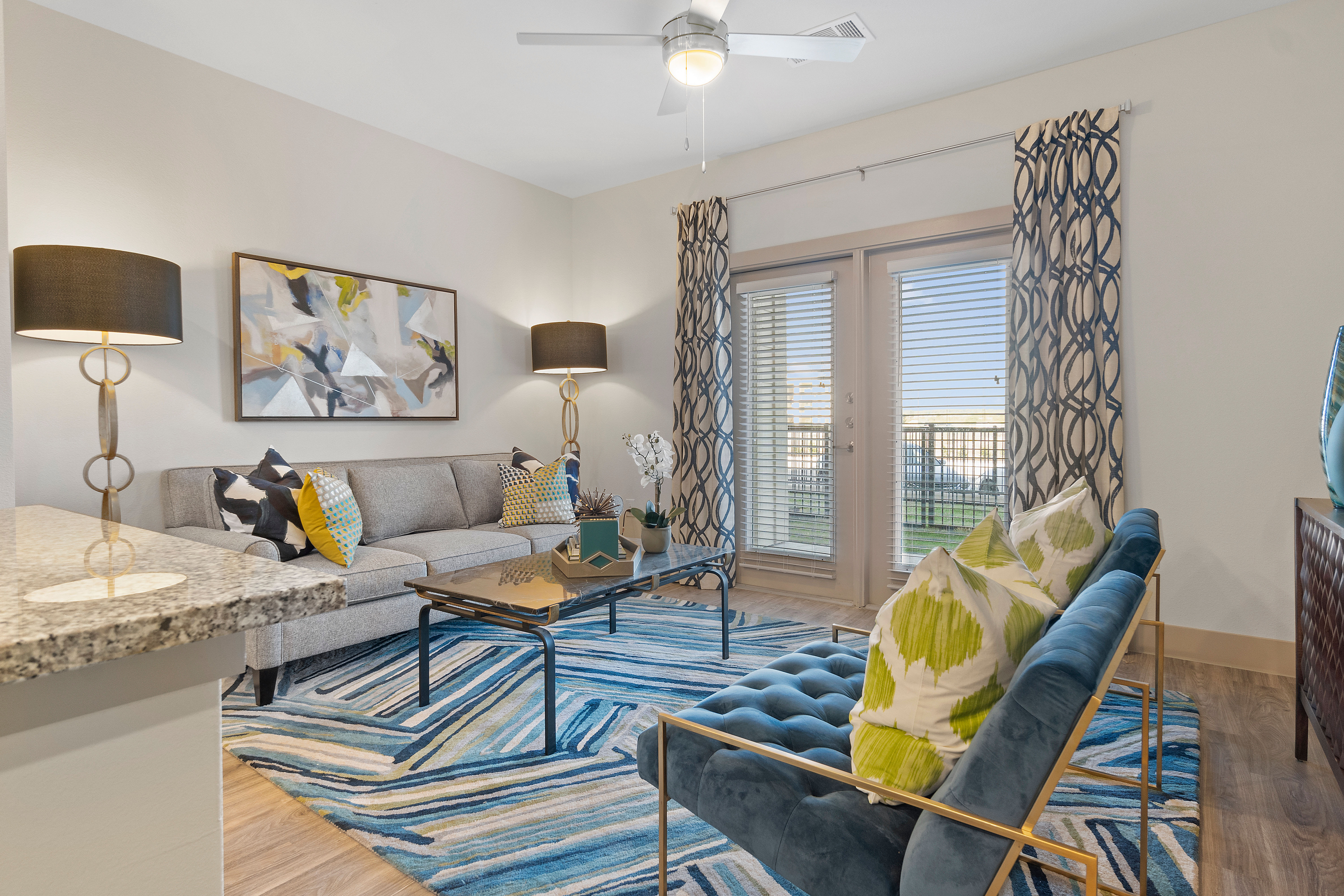 Living room with a large window at McCarty Commons in San Marcos, Texas