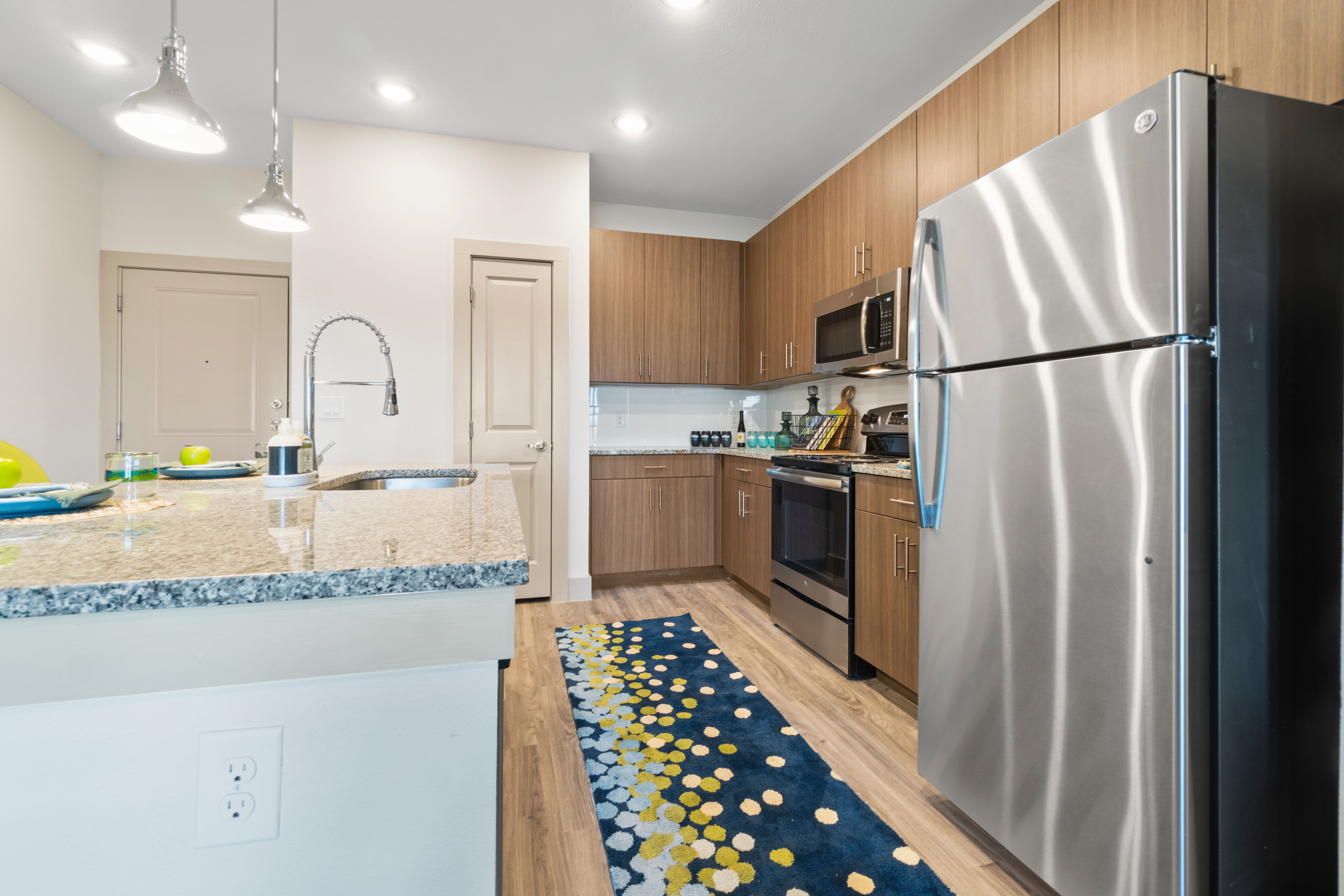 Kitchen with large countertop at McCarty Commons in San Marcos, Texas