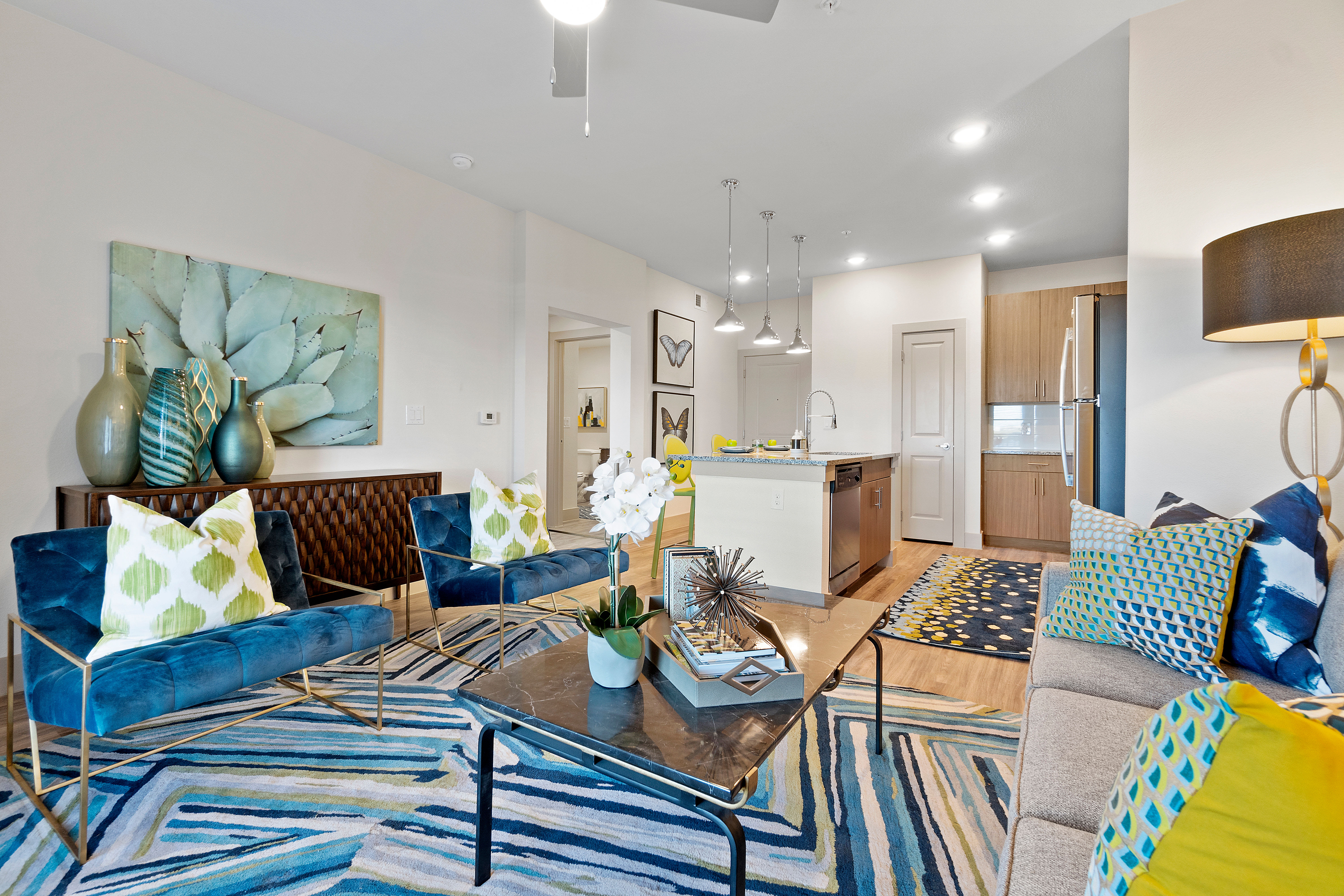 Living room with wood-style flooring at McCarty Commons in San Marcos, Texas