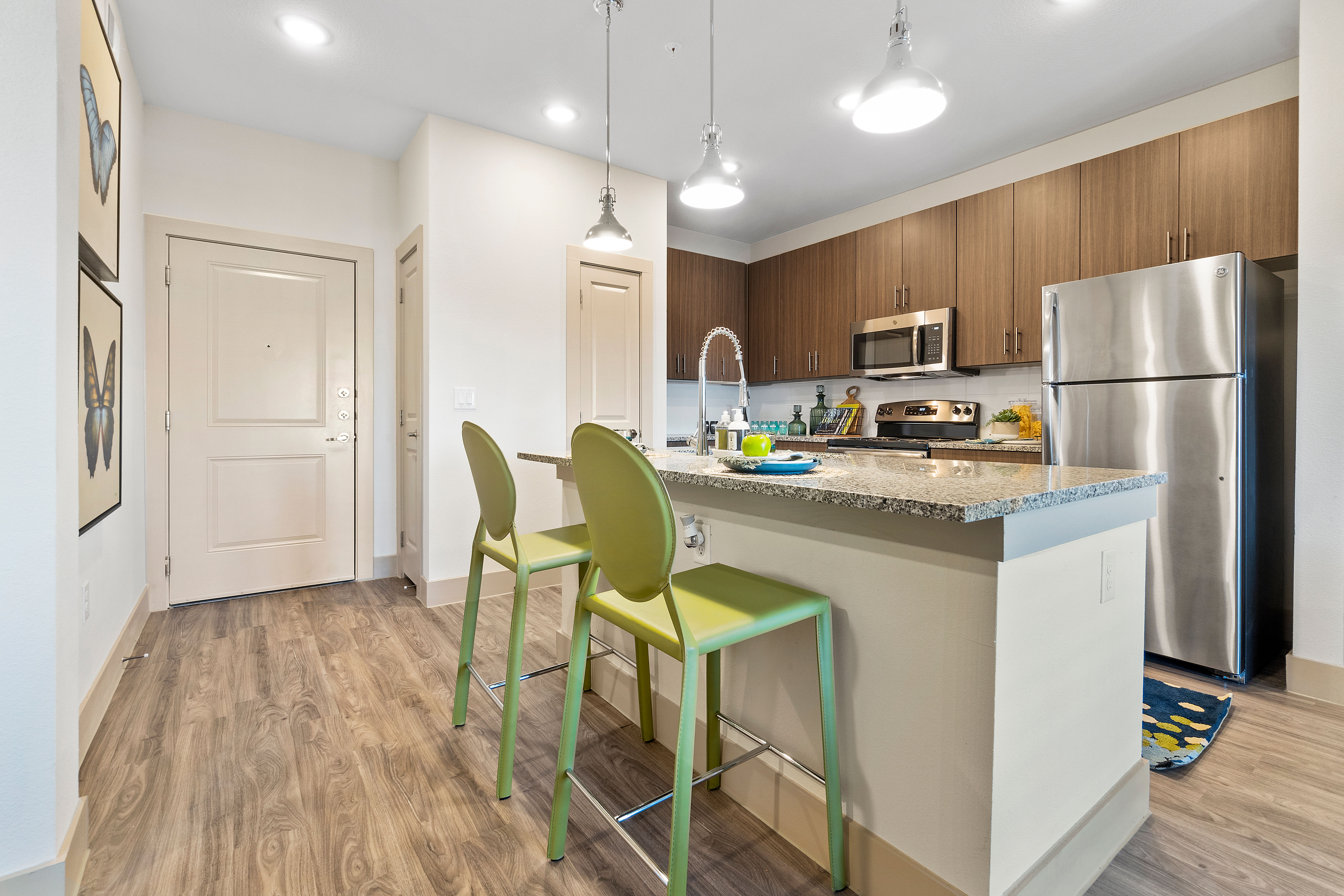 Kitchen with stainless-steel appliances at McCarty Commons in San Marcos, Texas