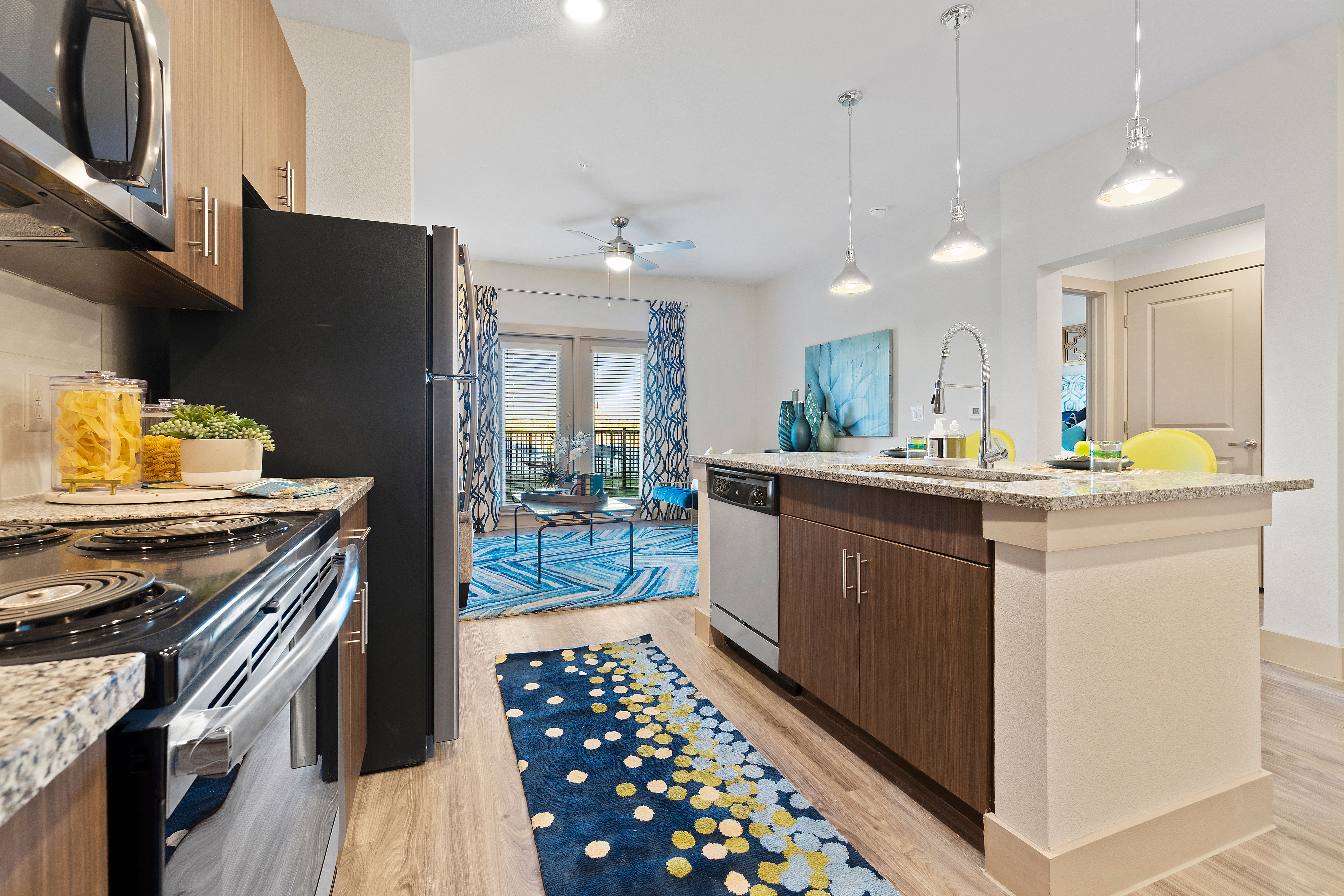 Kitchen with a breakfast bar at McCarty Commons in San Marcos, Texas