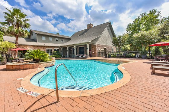 Resort-style swimming pool on a beautiful day at Stone Creek at The Woodlands in The Woodlands, Texas