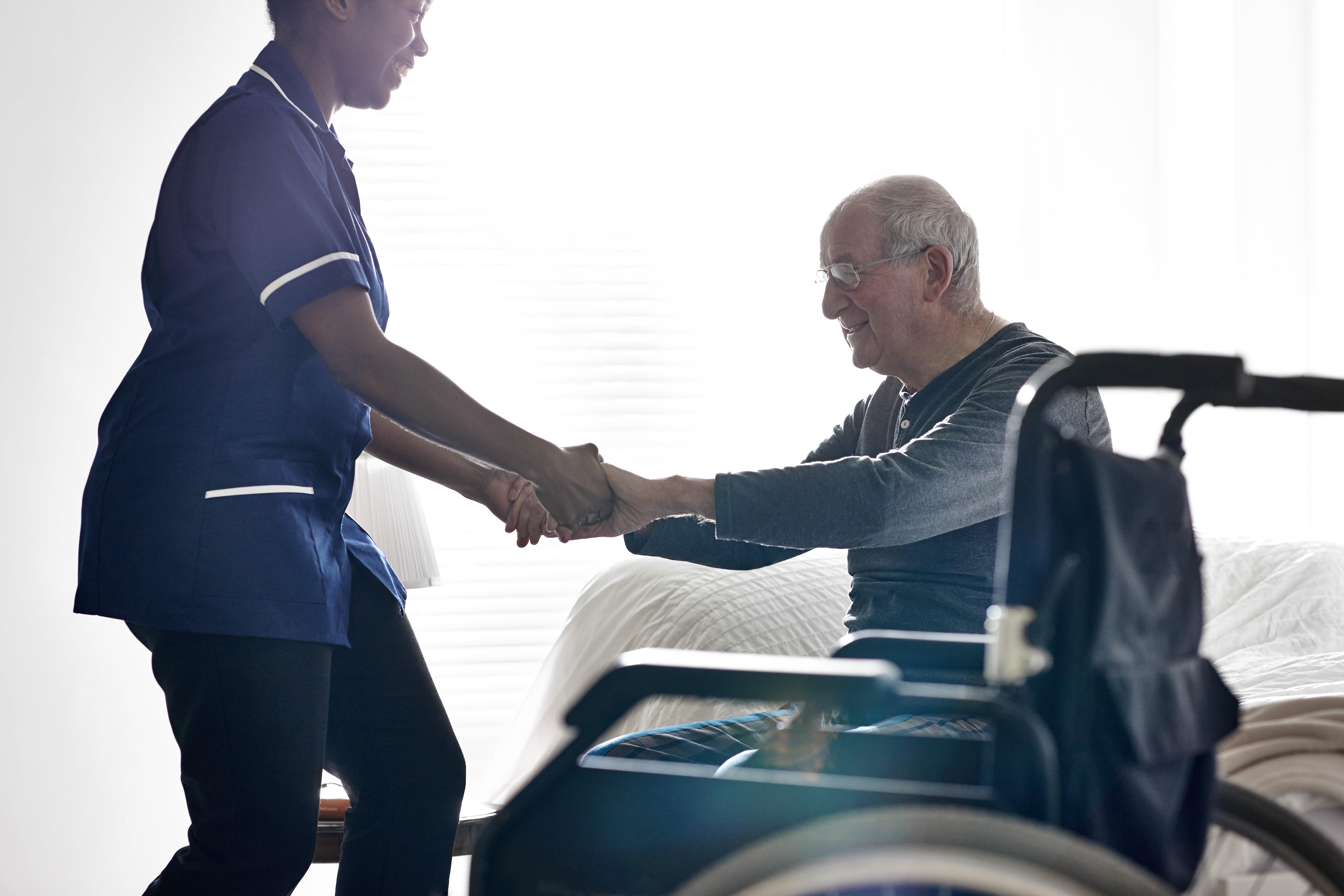 Caretaker assisting resident at York Gardens in Edina, MN