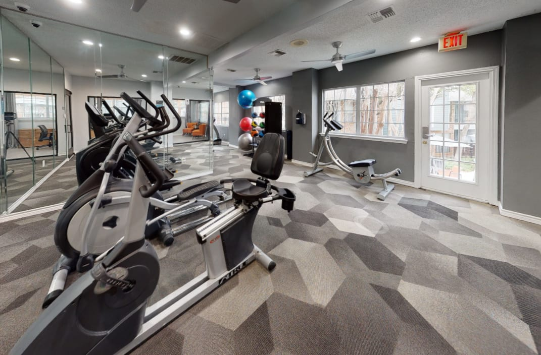 View virtual tour of the fitness center at Canopy on Central in Bedford, Texas