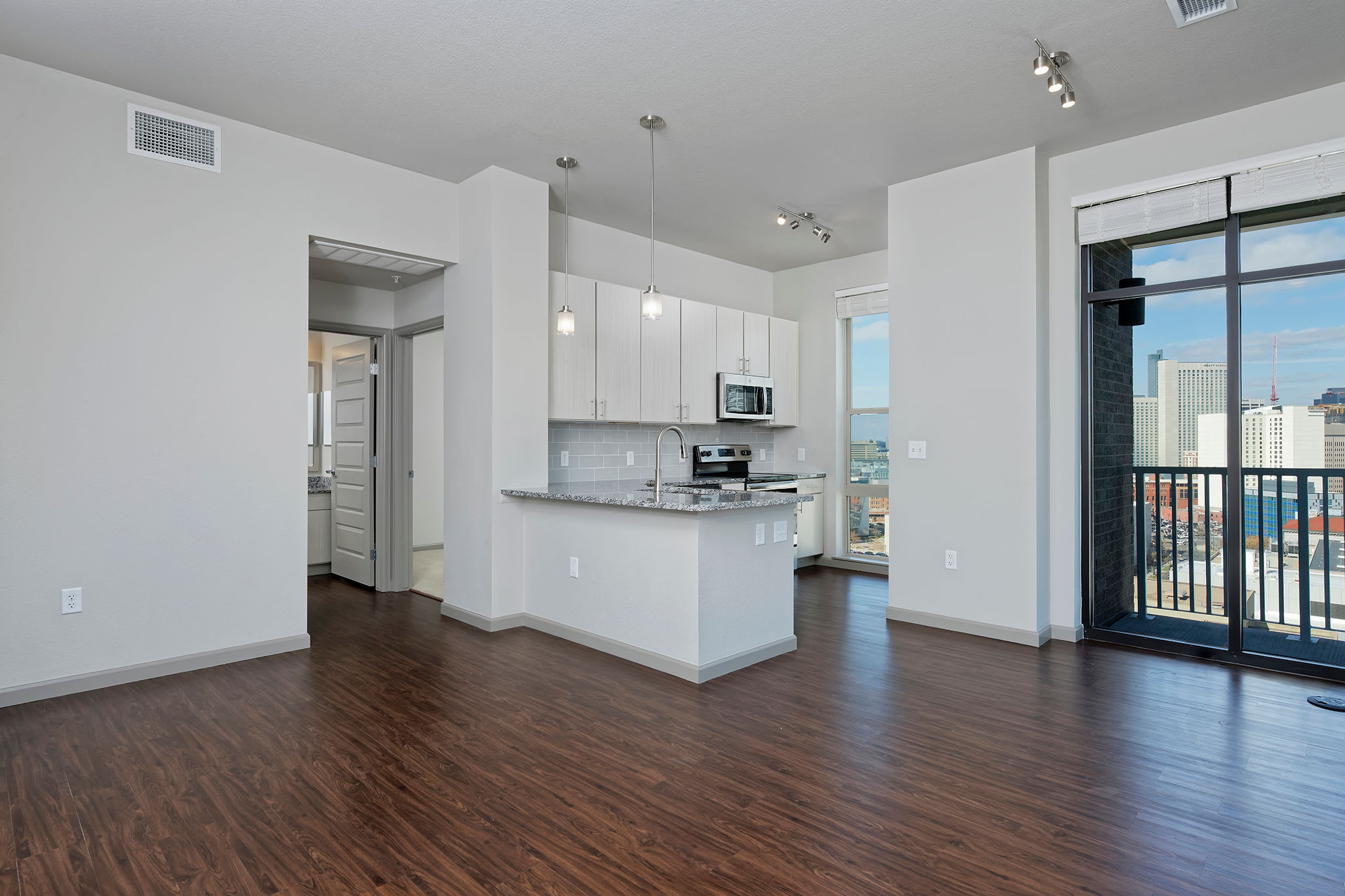 Open living rooms and kitchen area with a view at Civic Lofts in Downtown Denver, CO