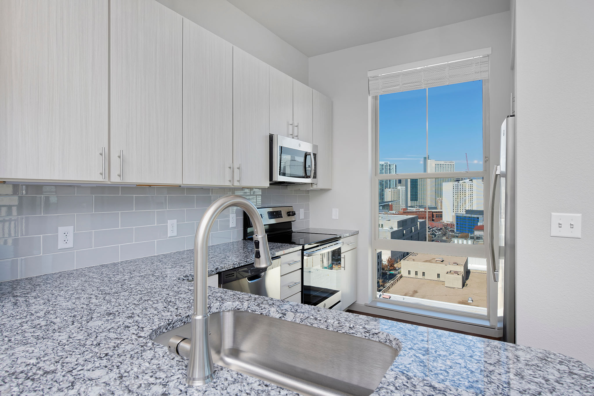 Marble counter sink with city views at Civic Lofts in Downtown Denver, CO