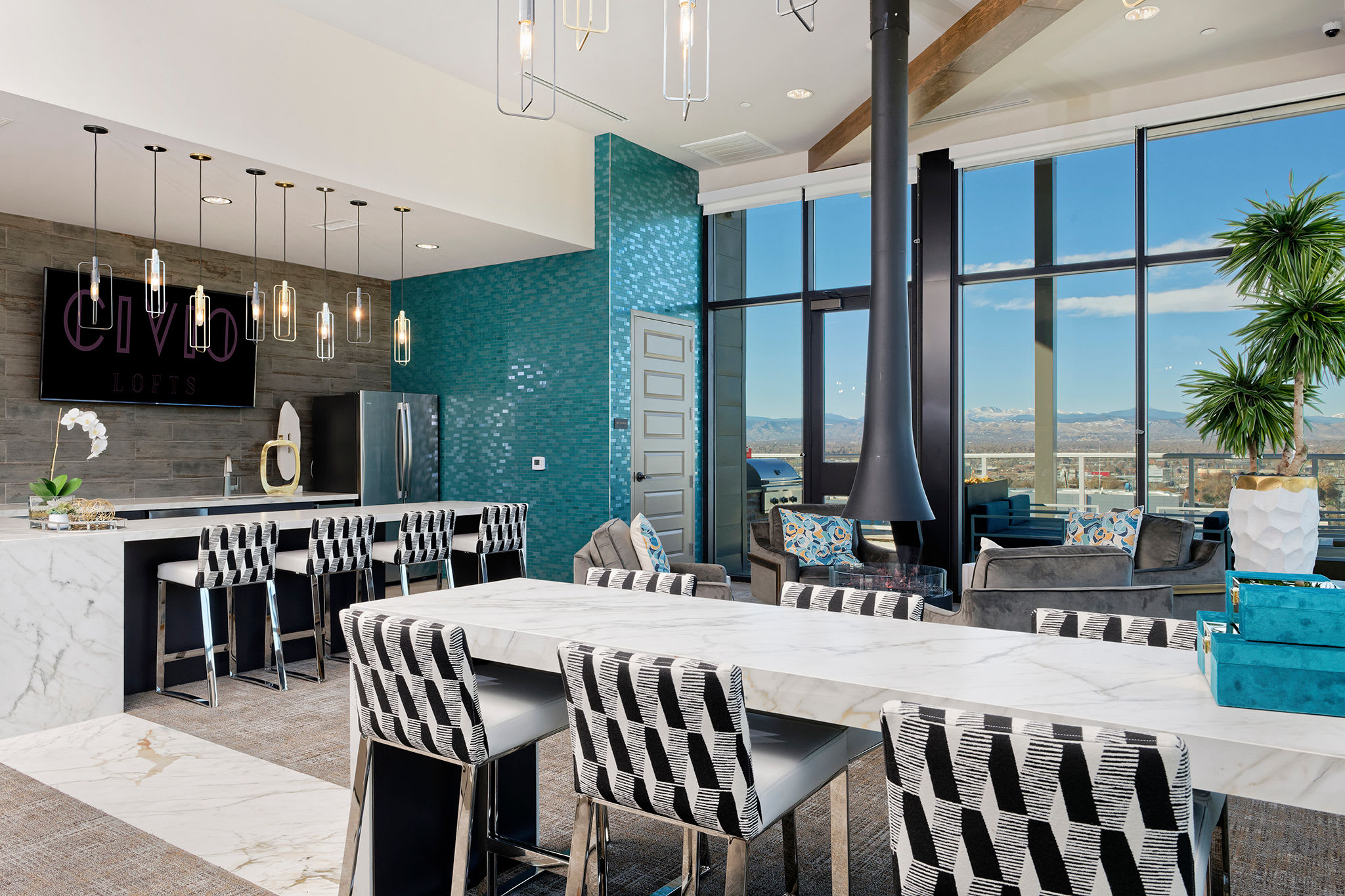 Bar seating with a view at the lounge area at Civic Lofts | Luxury Apartments in Downtown Denver, Colorado