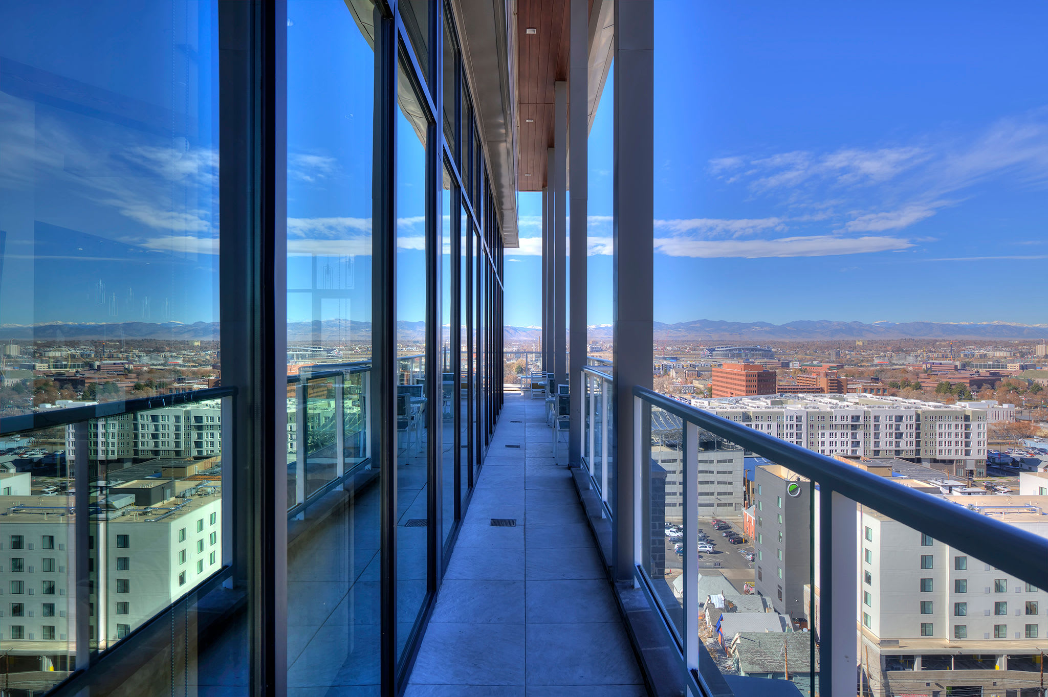 Skyline view from balcony seating area at Civic Lofts | Luxury Apartments in Downtown Denver, Colorado