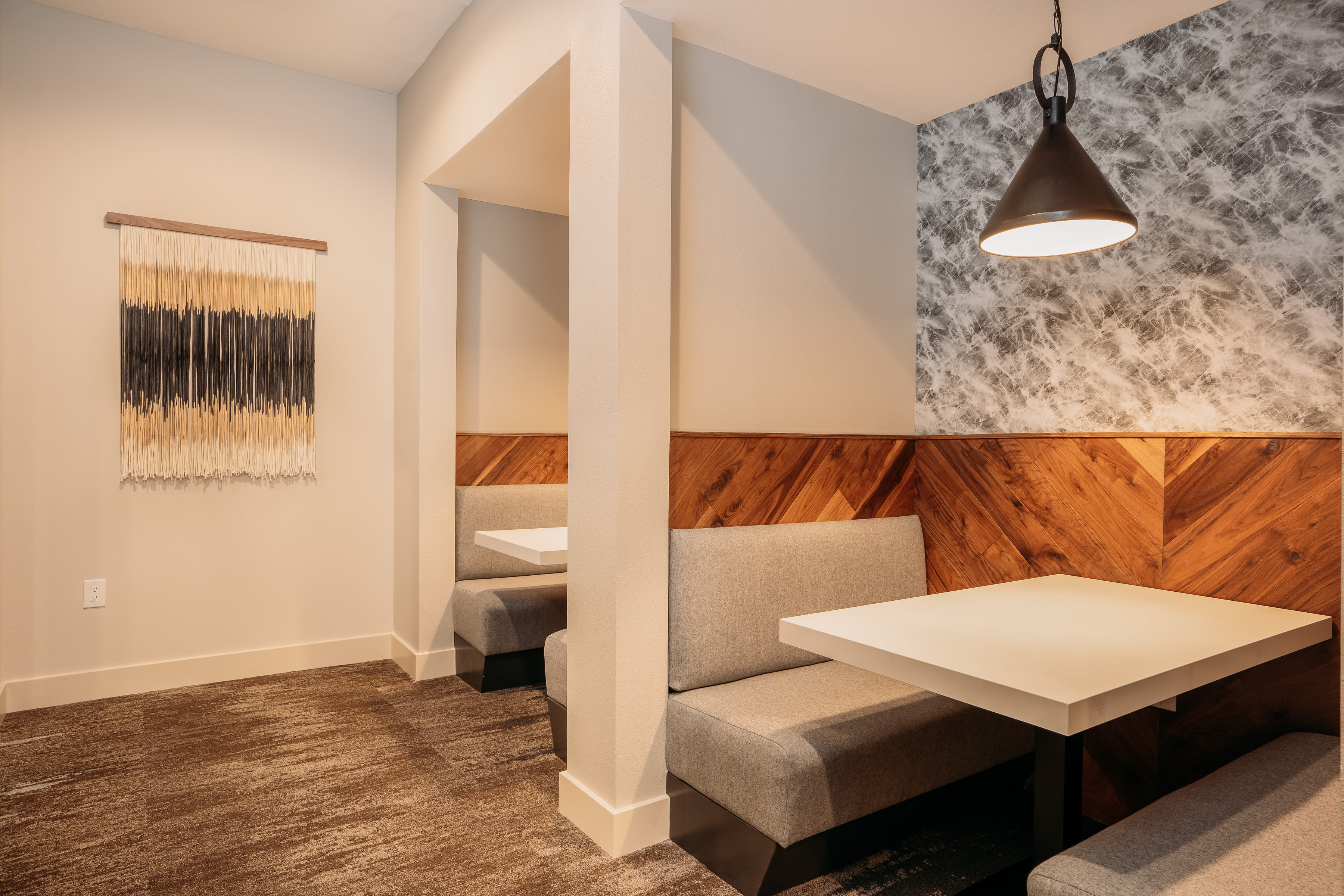 Booth seating with marble accents at Lakeshore Pearl in Austin, Texas