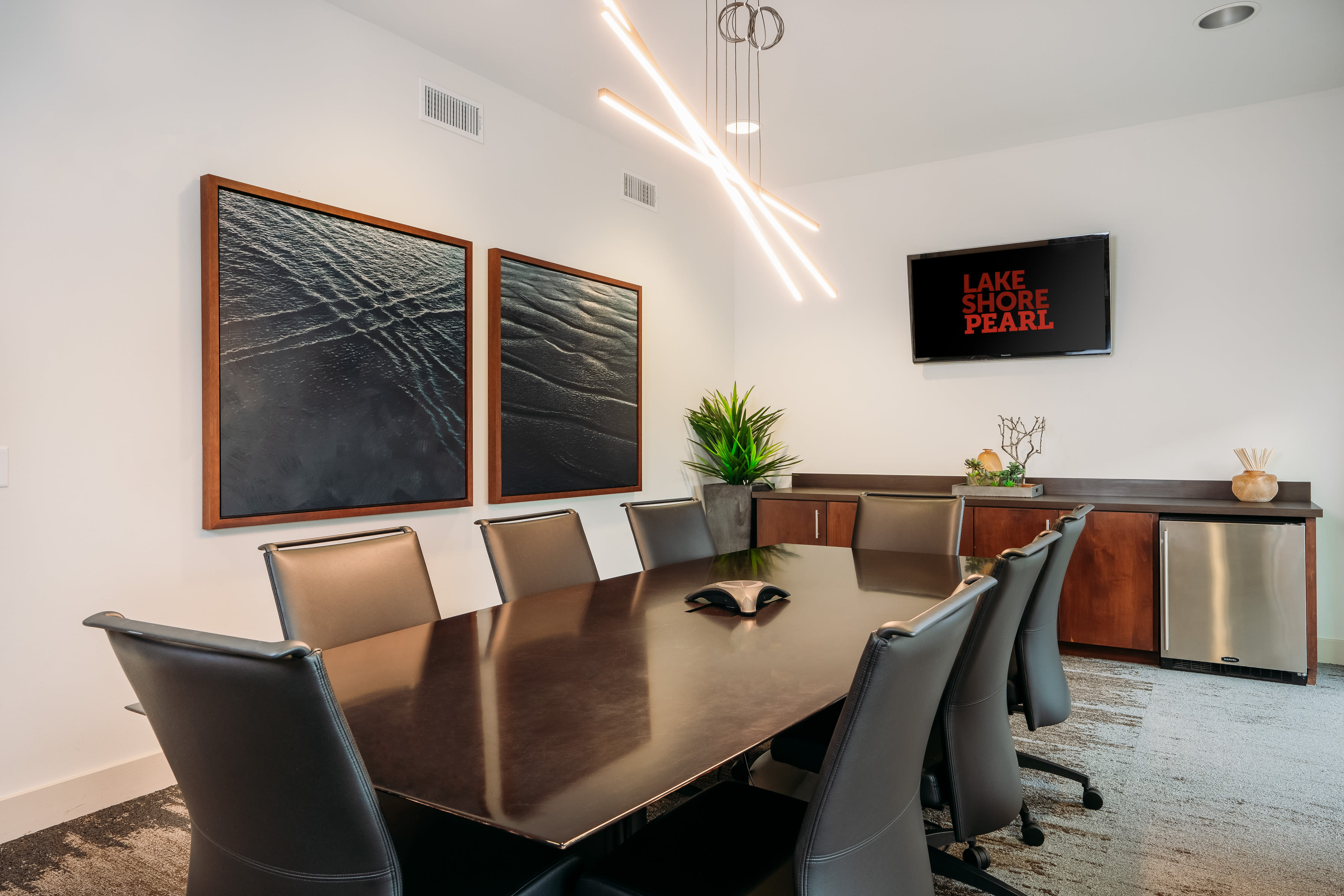 Business center with executive seating and fridge at Lakeshore Pearl in Austin, Texas