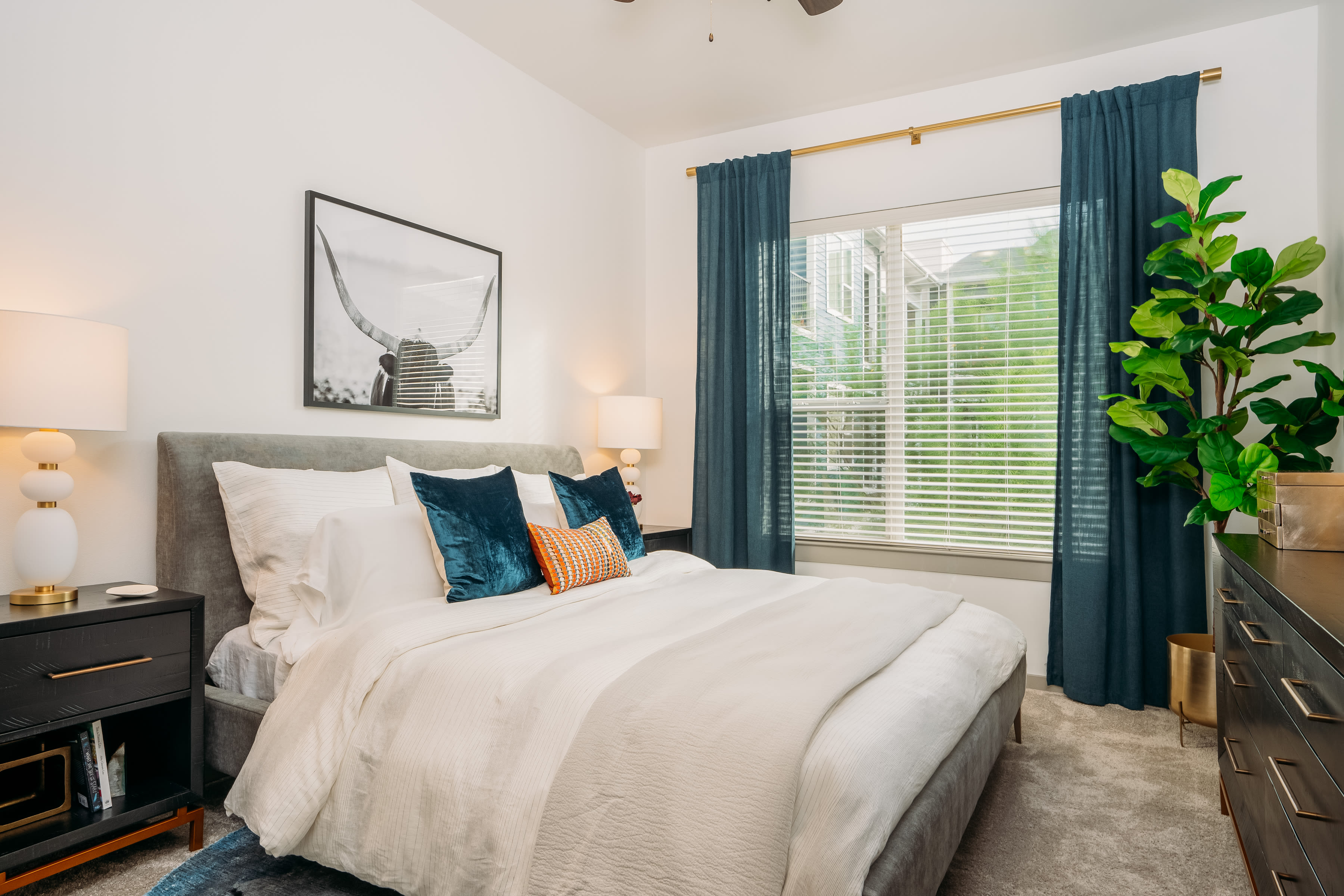 Primary bedroom with large window at Lakeshore Pearl in Austin, Texas