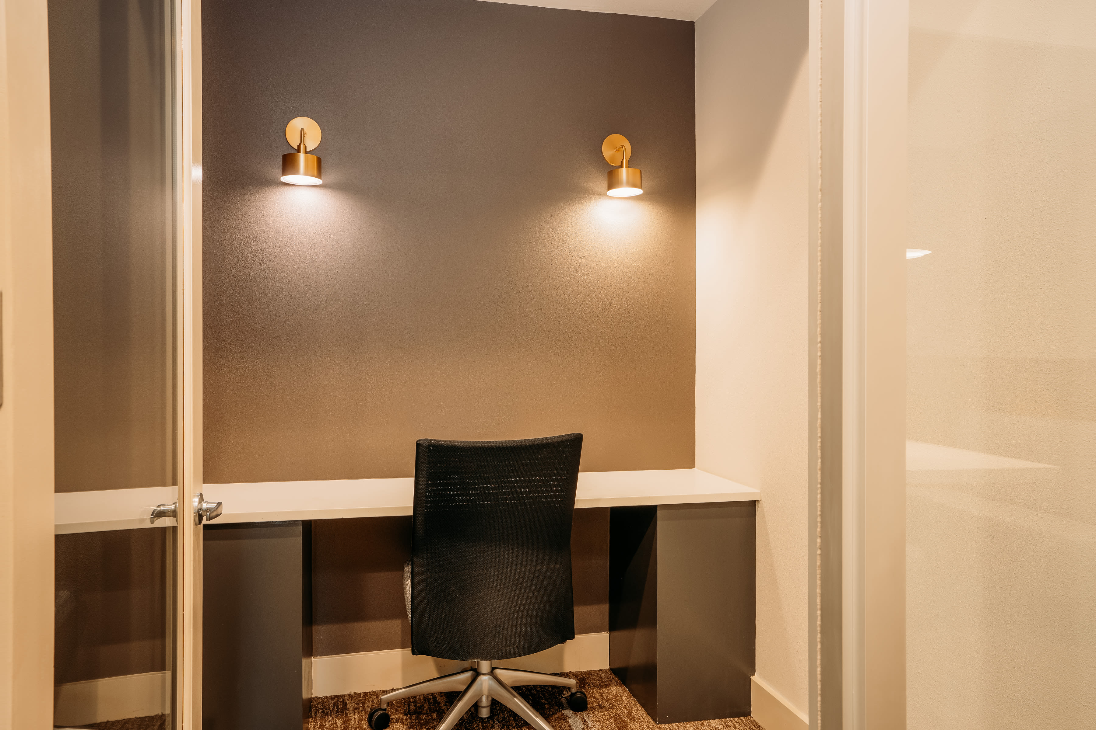 Private office area with accent wall at Lakeshore Pearl in Austin, Texas