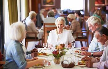 Group of friends enjoying a meal at Cascade Creek in Rochester, Minnesota.