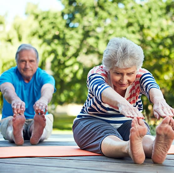 Some of our active residents taking a yoga class at Cascade Creek in Rochester, Minnesota