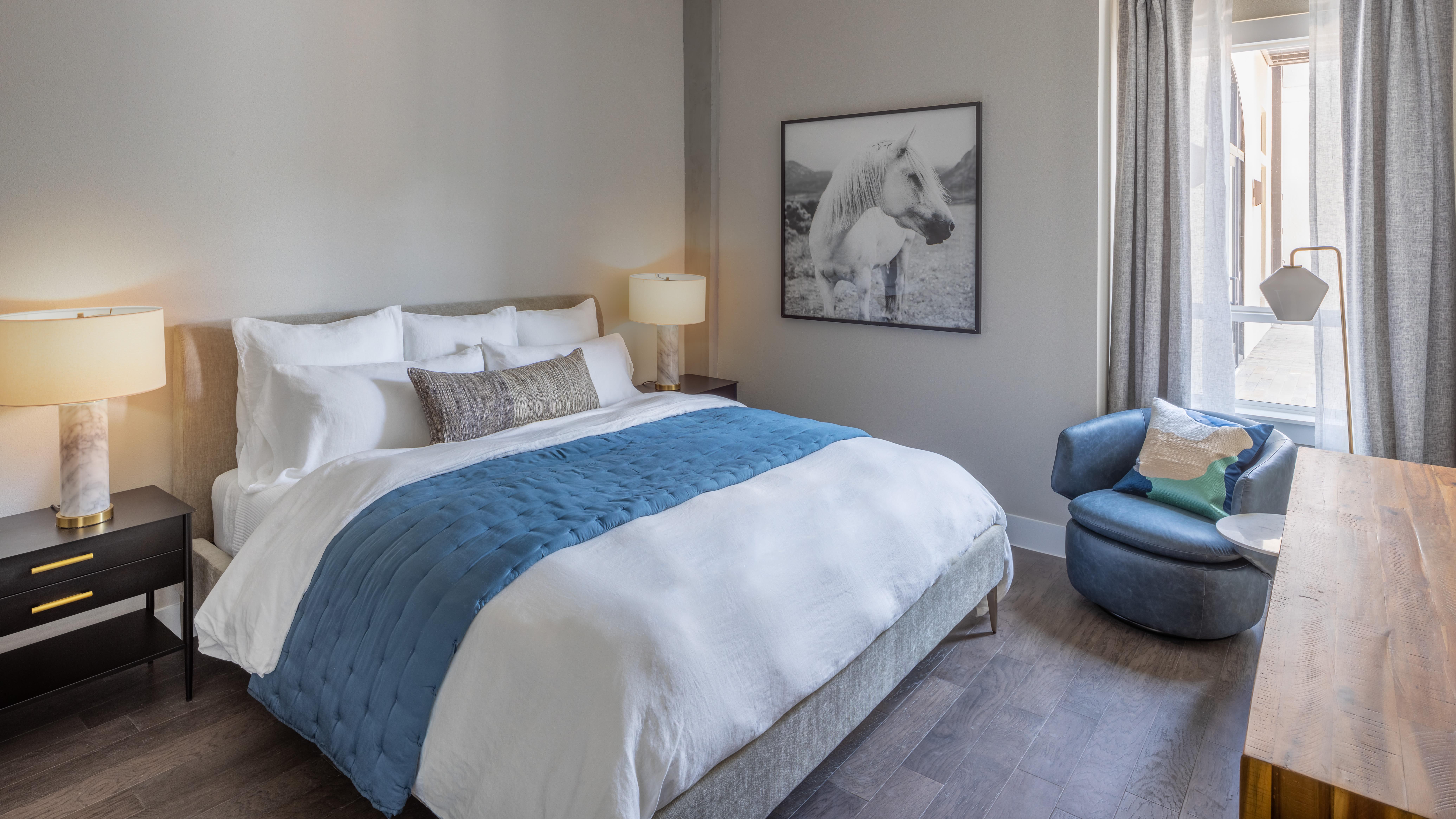 Relaxing bedroom with wood floors at Magnolia Heights in San Antonio, Texas