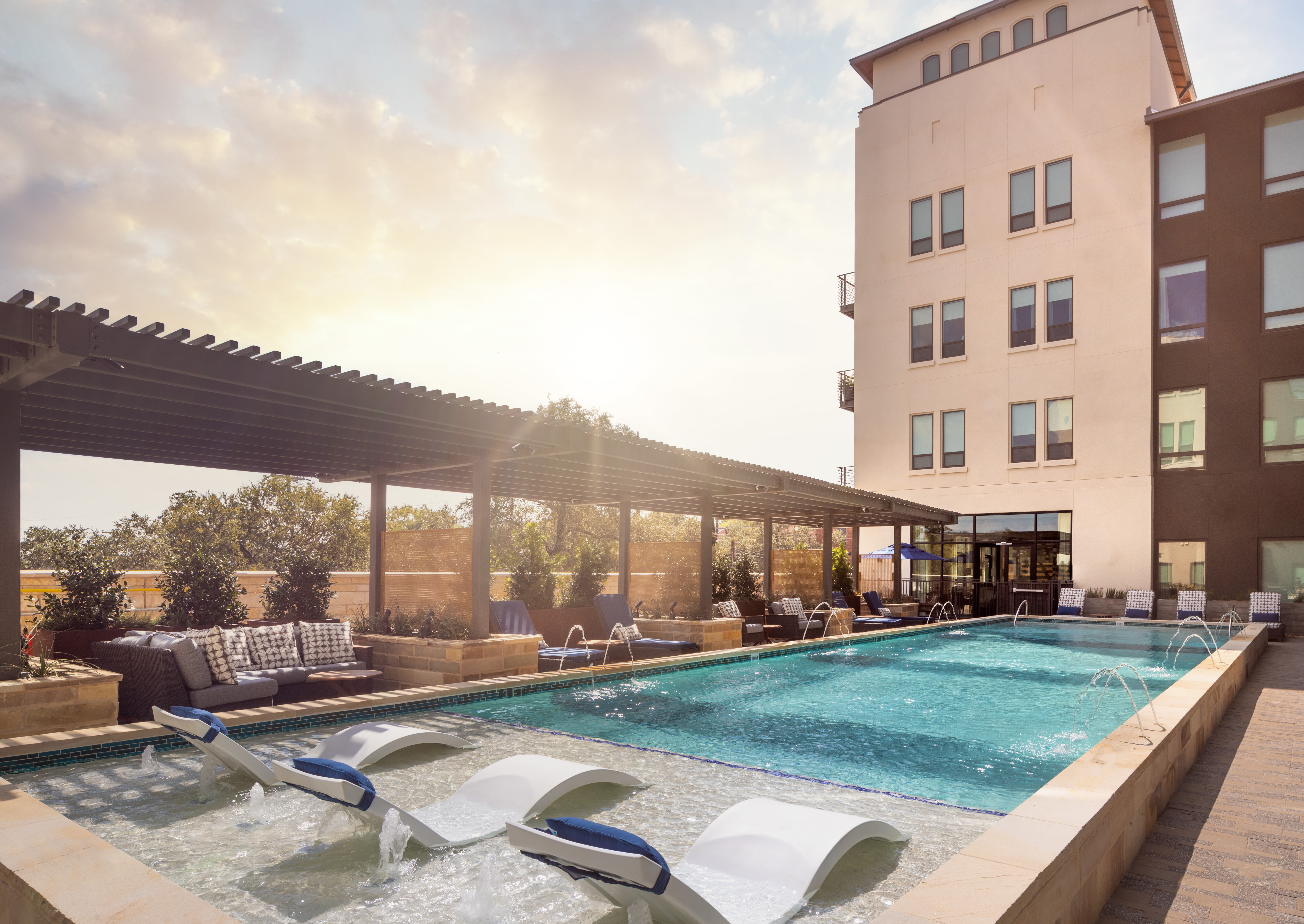 Sunset photo of the resort style pool at Magnolia Heights in San Antonio, Texas