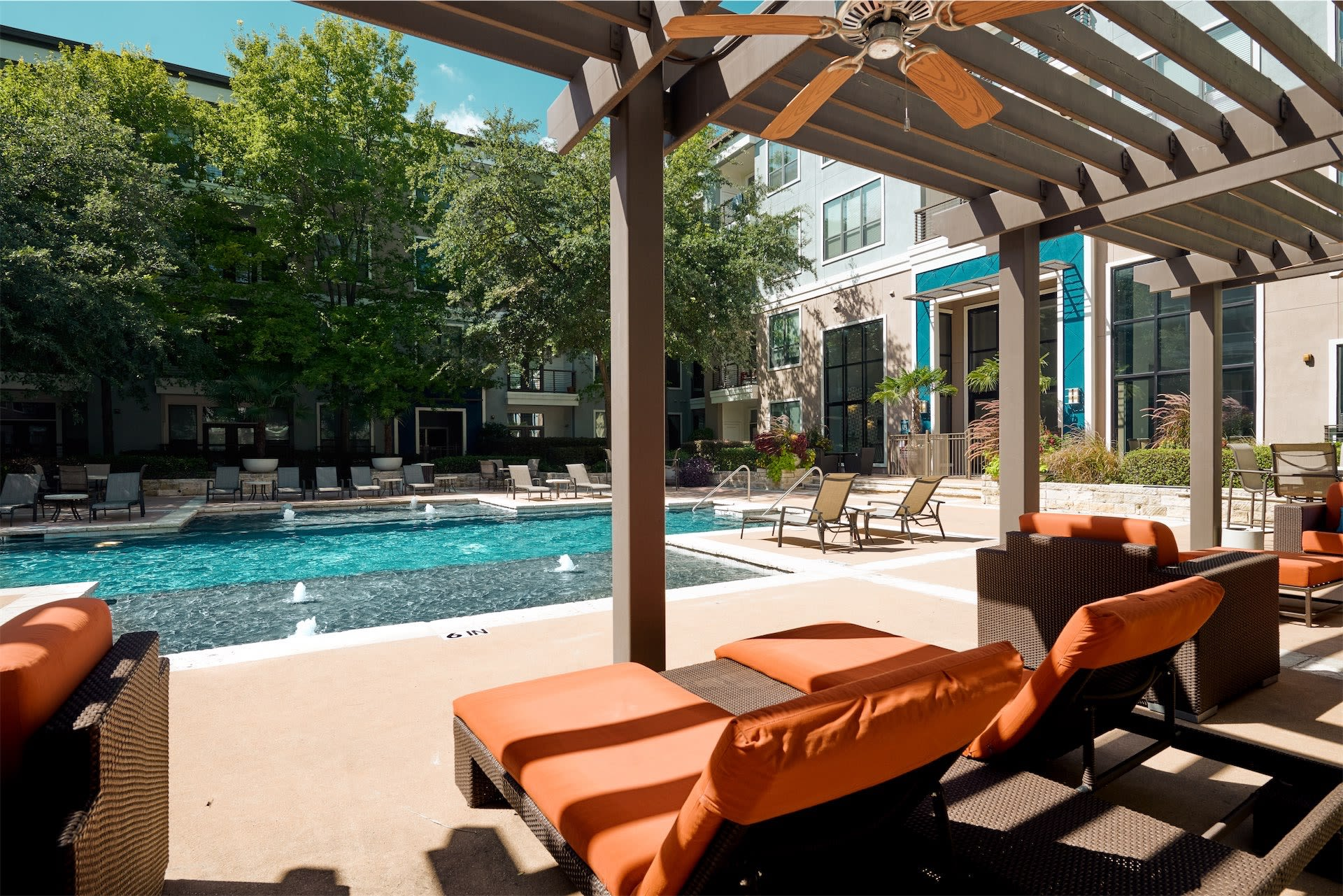 Relaxing poolside covered lounge area at Seville Uptown in Dallas, Texas